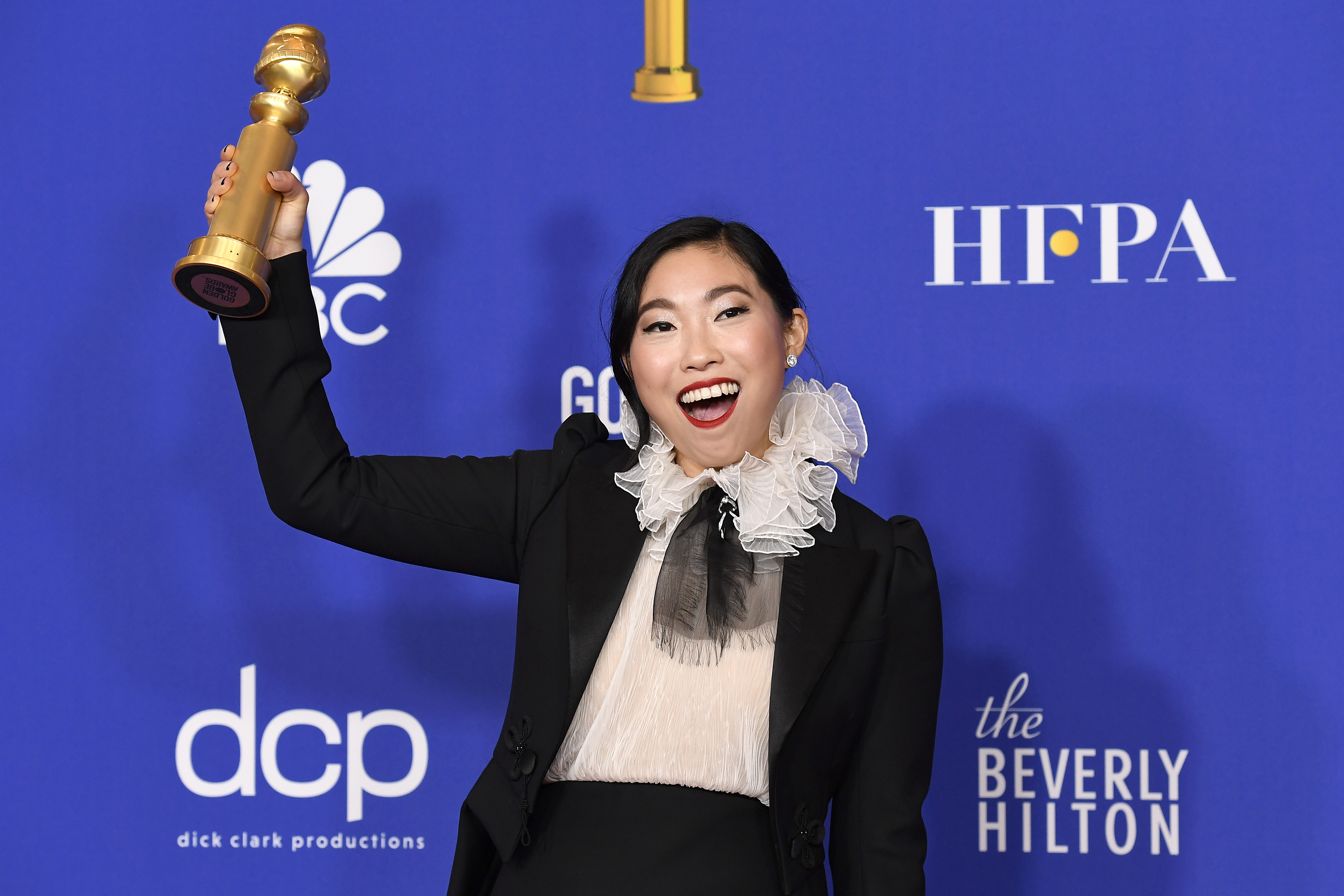 Awkwafina after winning the award for Best Performance by an Actress in a Motion Picture - Musical or Comedy for The Farewell.