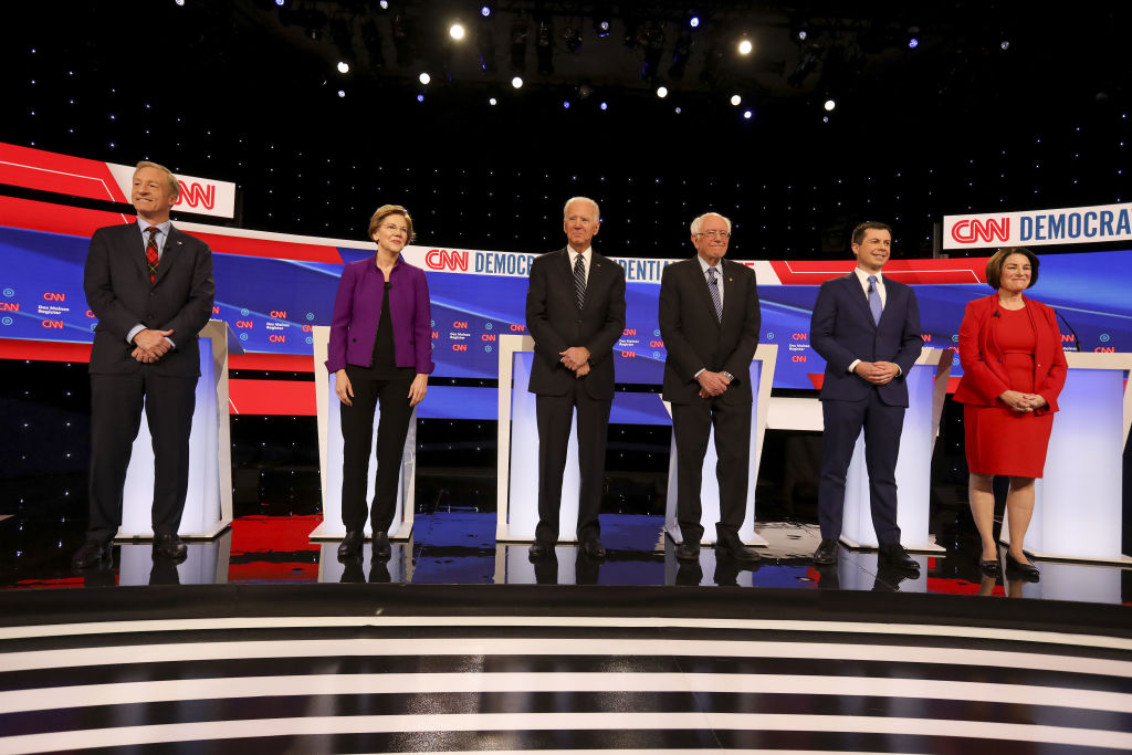 2020 Democratic presidential candidates, from left, Tom Steyer, co-founder of NextGen Climate Action Committee, Senator Elizabeth Warren, a Democrat from Massachusetts, Former U.S. Vice President Joe Biden, Senator Bernie Sanders, an independent from Vermont, Pete Buttigieg, former mayor of South Bend, and Senator Amy Klobuchar, a Democrat from Minnesota, stand on stage ahead of the Democratic presidential debate in Des Moines, Iowa, on Jan. 14, 2020.