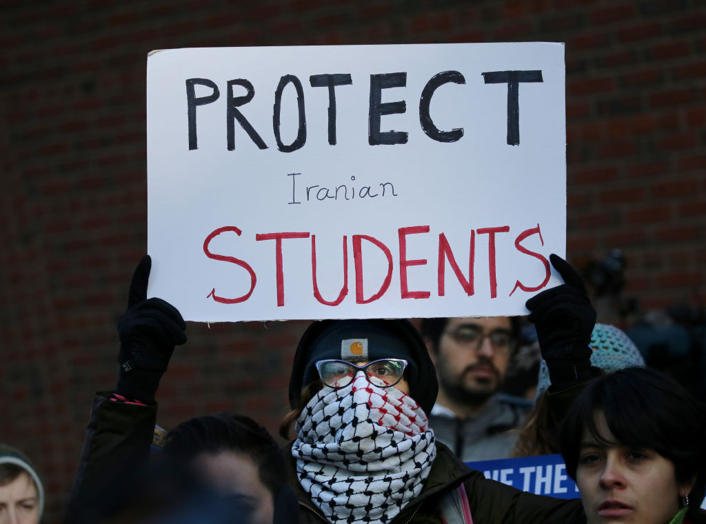 Cassidy Taylor offers support to a deported Iranian student while protesting outside the federal courthouse in Boston, Mass., on Jan. 21, 2020.