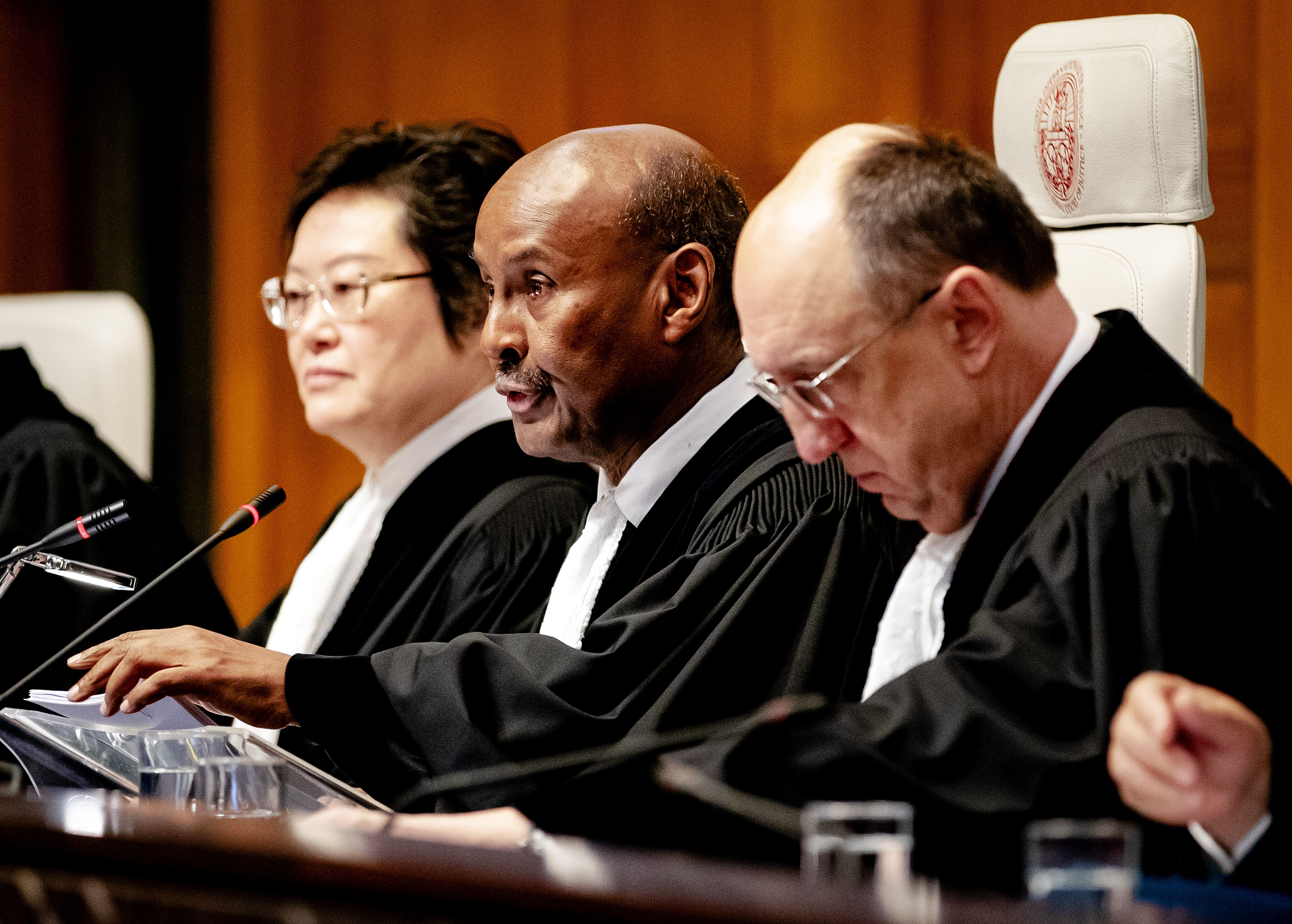 The president of the International Court of Justice, Abdulqawi Ahmed Yusuf (C) speaks during the ruling of the International Court of Justice in The Hague, on January 23, 2020 in the lawsuit filed by The Gambia against Myanmar in which Myanmar is accused of genocide against Rohingya Muslims.