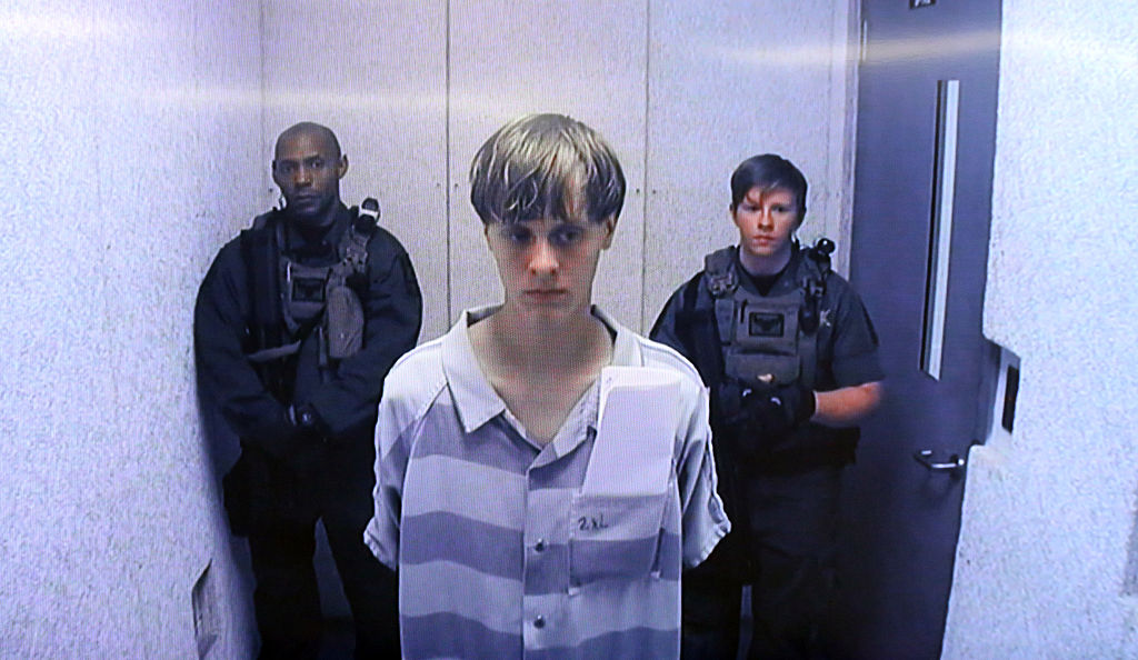 In this image from the video uplink from the detention center to the courtroom, Dylann Roof appears at Centralized Bond Hearing Court in North Charleston, S.C., on June, 19, 2015.