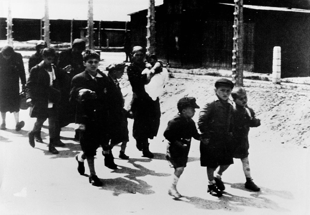 Auschwitz detainees walking to gas chambers. Many of the French Jews rounded up in Paris during the Vel D'Hiv deportation in July 1942 were sent to Auschwitz.