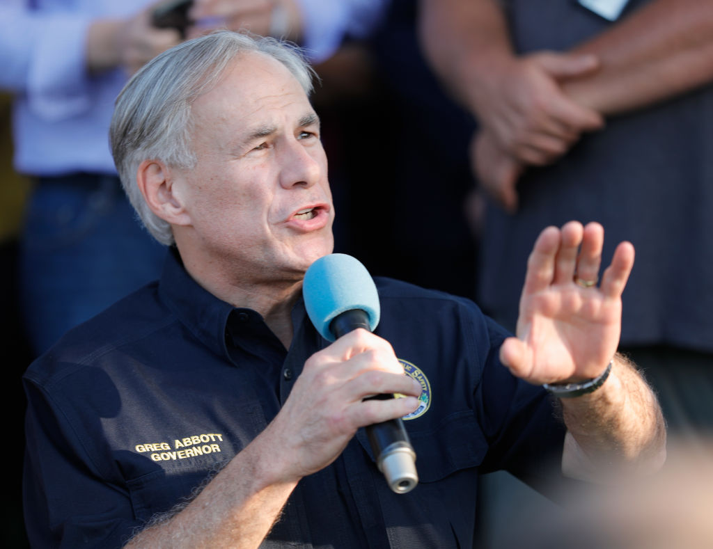 Texas Governor Greg Abbott speaks to family  and friends at a vigil held at the First Bank in Santa Fe for the victims of a shooting incident at Santa Fe High School where a shooter killed at least 10 students on May 18, 2018 in Santa Fe, Texas.