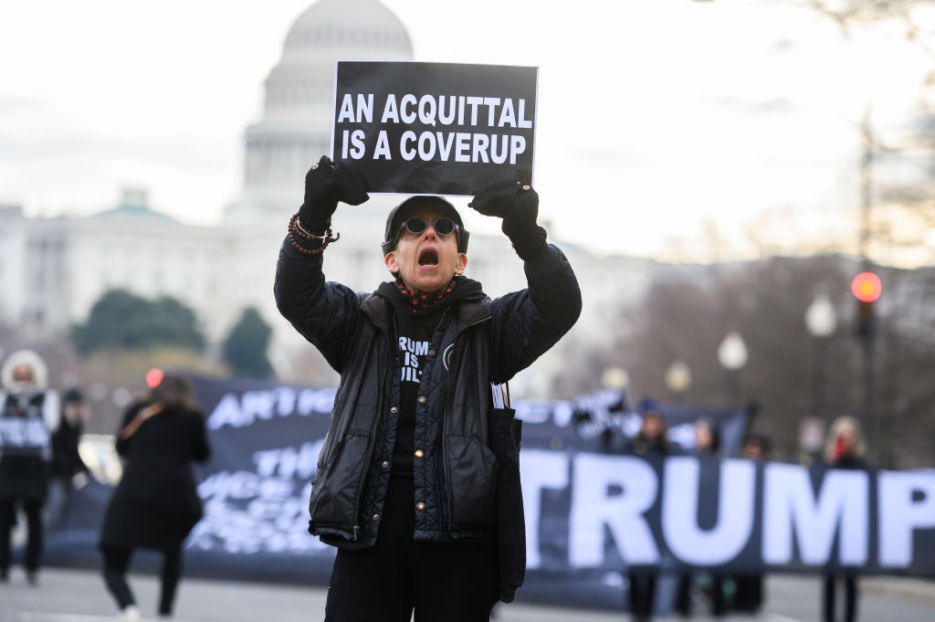 UNITED STATES - JANUARY 31: Laurie Arbeiter demonstrates on Pennsylvania Avenue before the continuation of the impeachment trial of President Donald Trump on Friday, January 31, 2020. (Photo By Tom Williams/CQ-Roll Call, Inc via Getty Images)