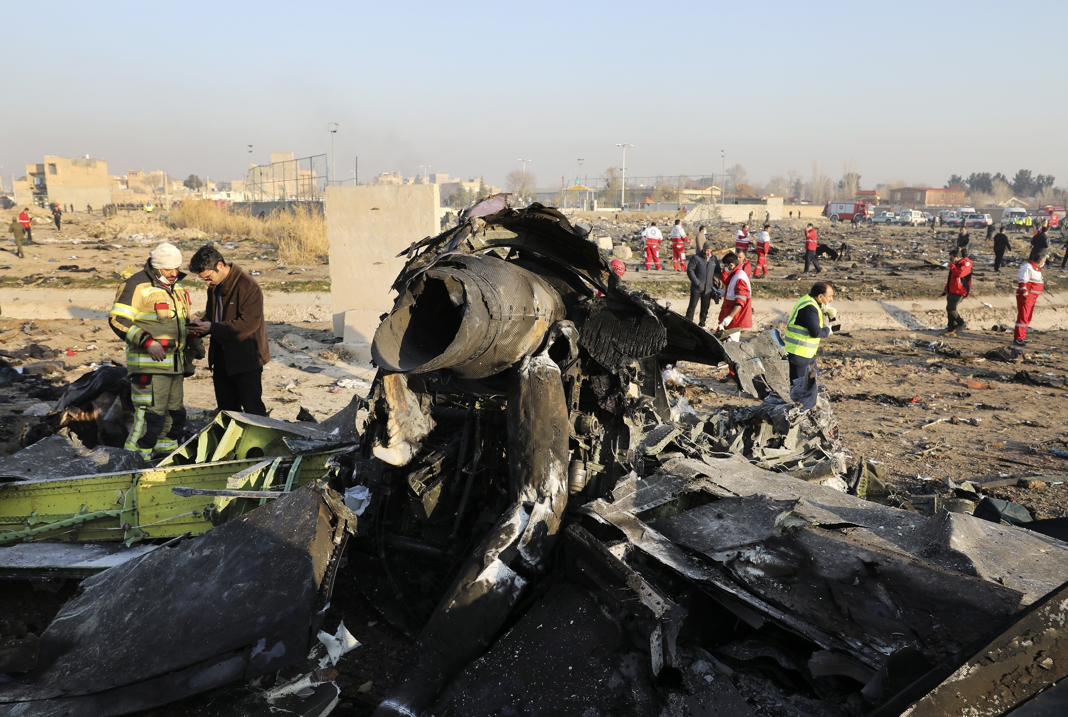 """In this Wednesday, Jan. 8, 2020 file photo, debris at the scene where a Ukrainian plane crashed in Shahedshahr southwest of the capital Tehran, Iran. Iran announced Saturday, Jan. 11, that its military """"unintentionally"""" shot down the Ukrainian jetliner that crashed earlier this week, killing all 176 aboard, after the government had repeatedly denied Western accusations that it was responsible."""