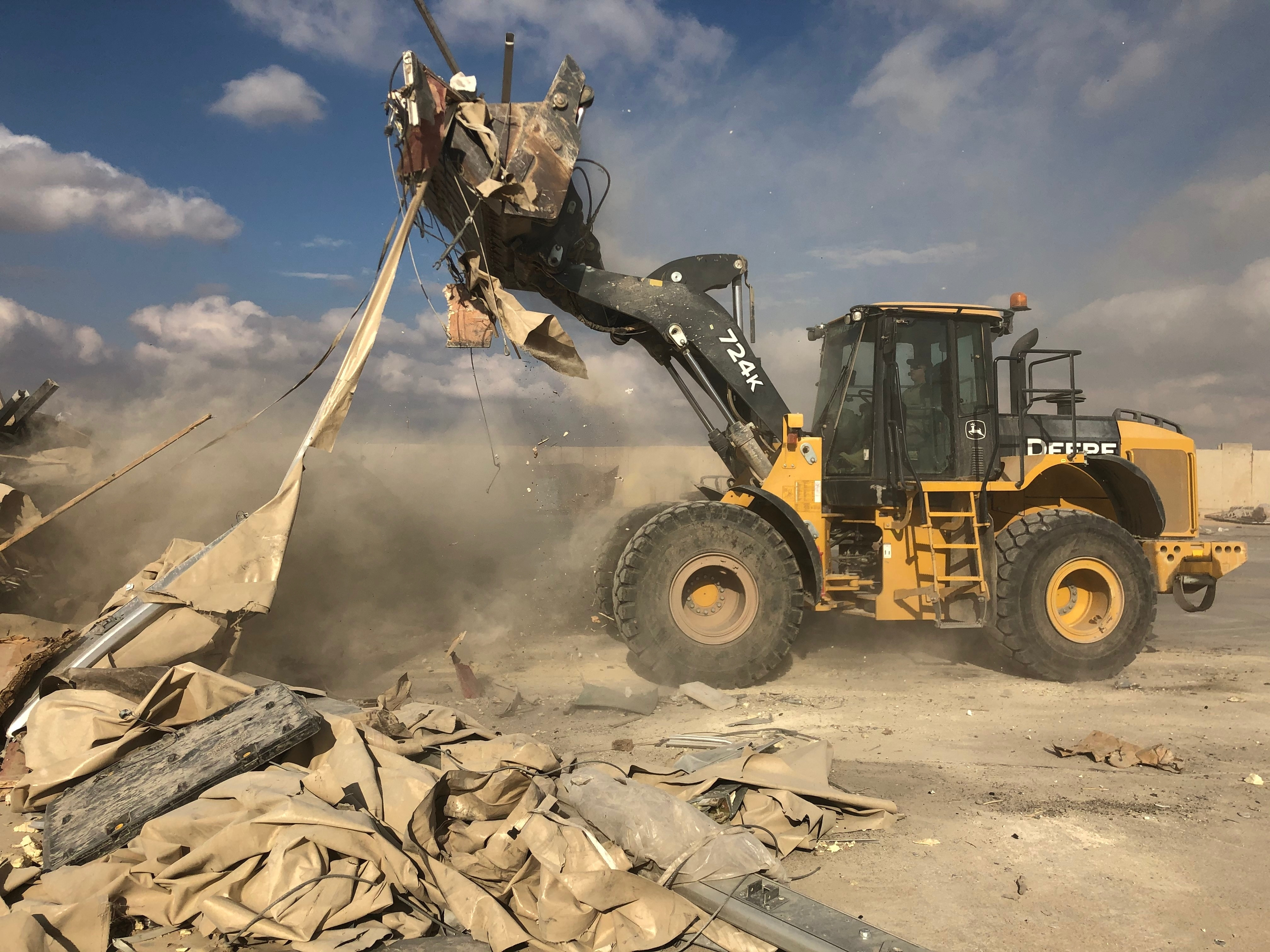 A bulldozer clears rubble and debris at Ain al-Asad air base in Anbar, Iraq, Monday, Jan. 13, 2020. Ain al-Asad air base was struck by a barrage of Iranian missiles on Wednesday, in retaliation for the U.S. drone strike that killed atop Iranian commander, Gen. Qassem Soleimani, whose killing raised fears of a wider war in the Middle East.