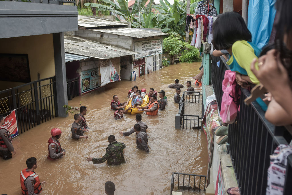 A rescue team evacuates residents from their flooded houses in Jakarta on Jan. 1, 2020.                       Severe floods hit Indonesias capital as residents were celebrating New Years, killing at least 16 people, displacing thousands and forcing the closure of a domestic airport.