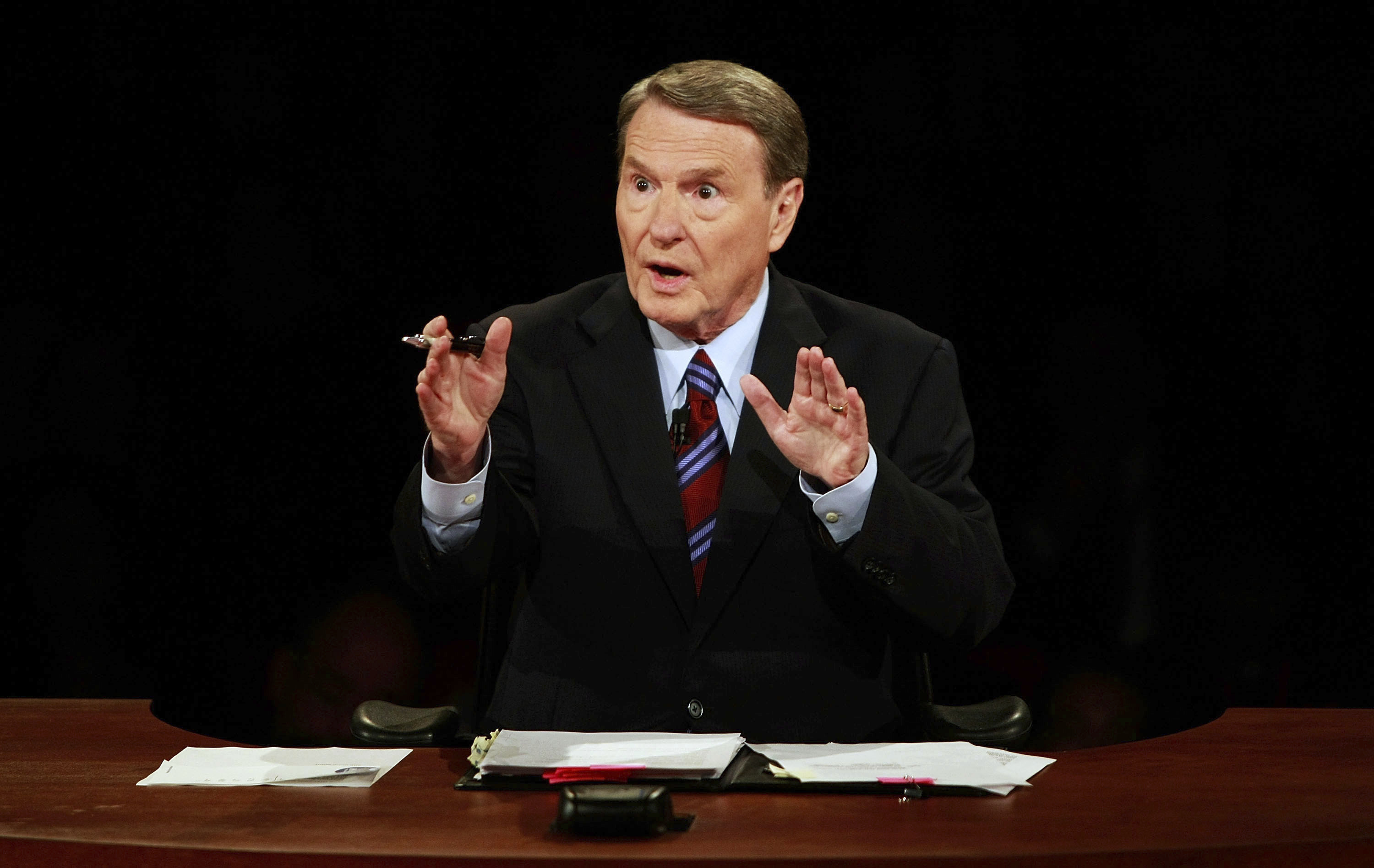 This Sept. 26, 2008 file photo shows debate moderator Jim Lehrer during the first U.S. Presidential Debate between presidential nominees Sen. John McCain, R-Ariz., and Sen. Barack Obama, D-Ill., at the University of Mississippi in Oxford, Miss.