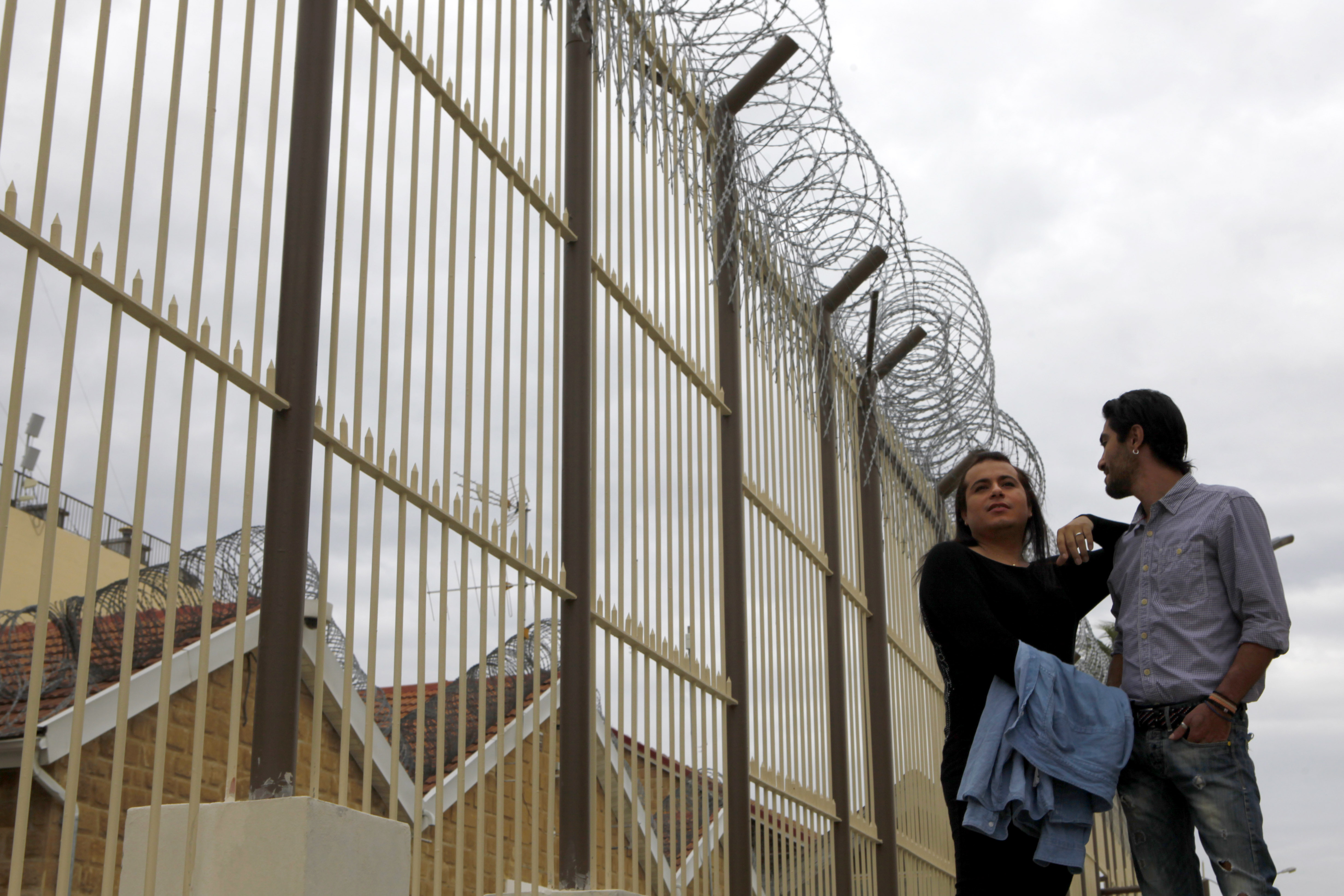 Cypriot Kevork Tontian, right, and Brazilian Wemson Gabral da Costa walk inside the Cyprus' prisons in capital Nicosia, Cyprus, Thursday, Jan. 16, 2020.