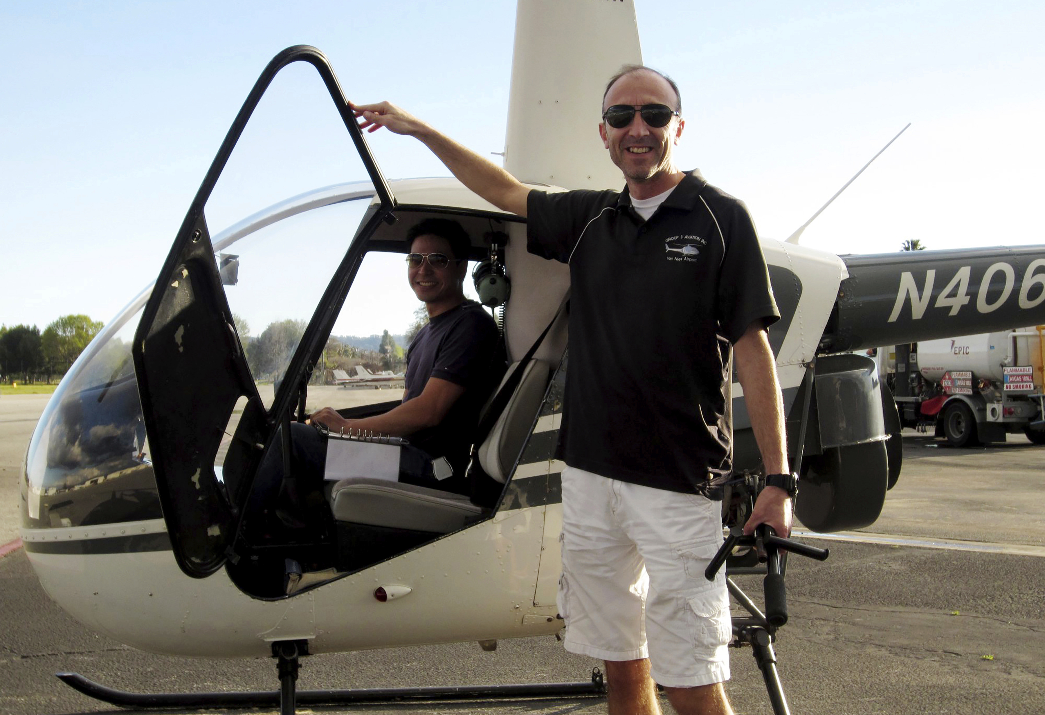 This undated file photo provided by Group 3 Aviation shows helicopter pilot Ara Zobayan standing outside a helicopter, at a location not provided. Zobayan was at the controls of the helicopter that crashed in Southern California Sunday, Jan. 26, 2020, killing all nine aboard including former Lakers star Kobe Bryant. The other person inside is unidentified. Zobayan's life in the cockpit began as a passenger, a tourist looking out of a helicopter into the vast Grand Canyon. It would be a transformational trip, prompting Zobayan in 1998 to learn to pilot the aircraft himself.