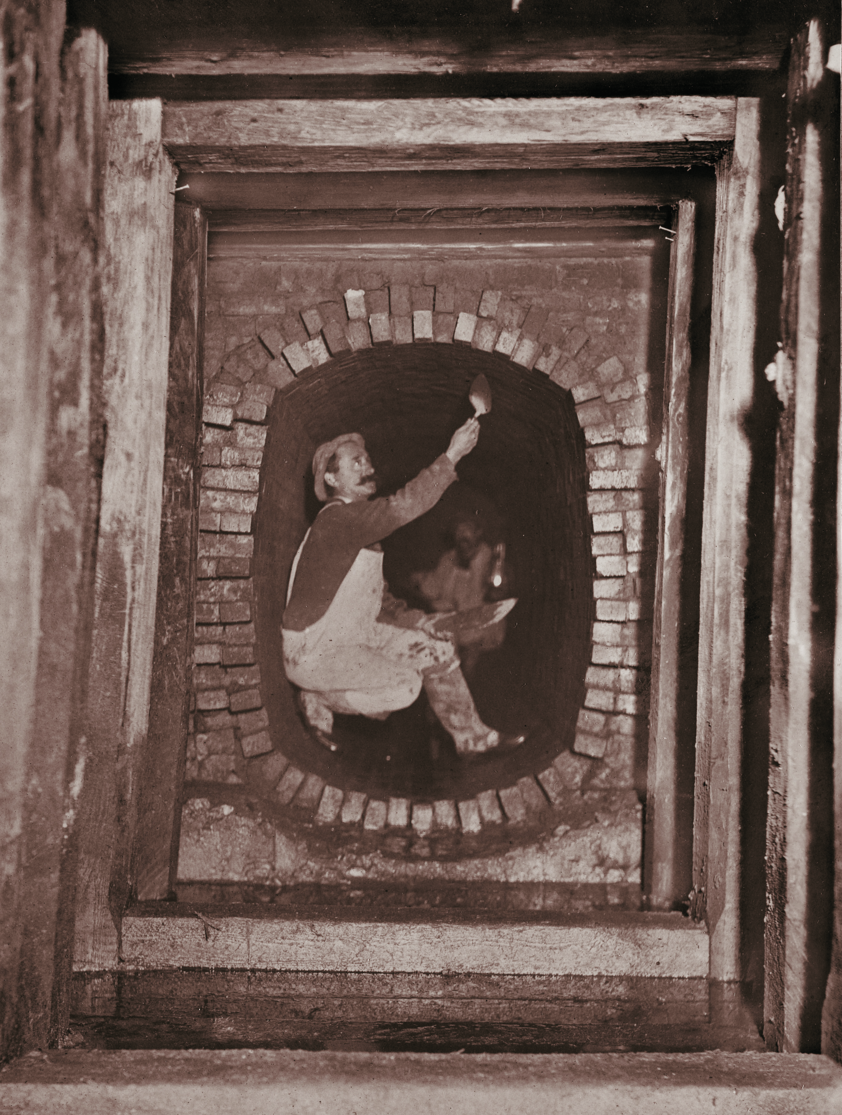 A man is pictured mortaring a sewer wall in 1880s Boston. Mortaring the inside of the sewer is designed to make the sewer impermeable to water