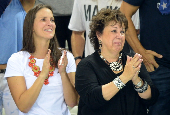 Debbie Phelps (R), mother of U.S. swimmer Michael Phelps cries during the podium ceremony of the men's 4x200m freestyle relay final during the swimming event at the London 2012 Olympic Games on July 31, 2012.