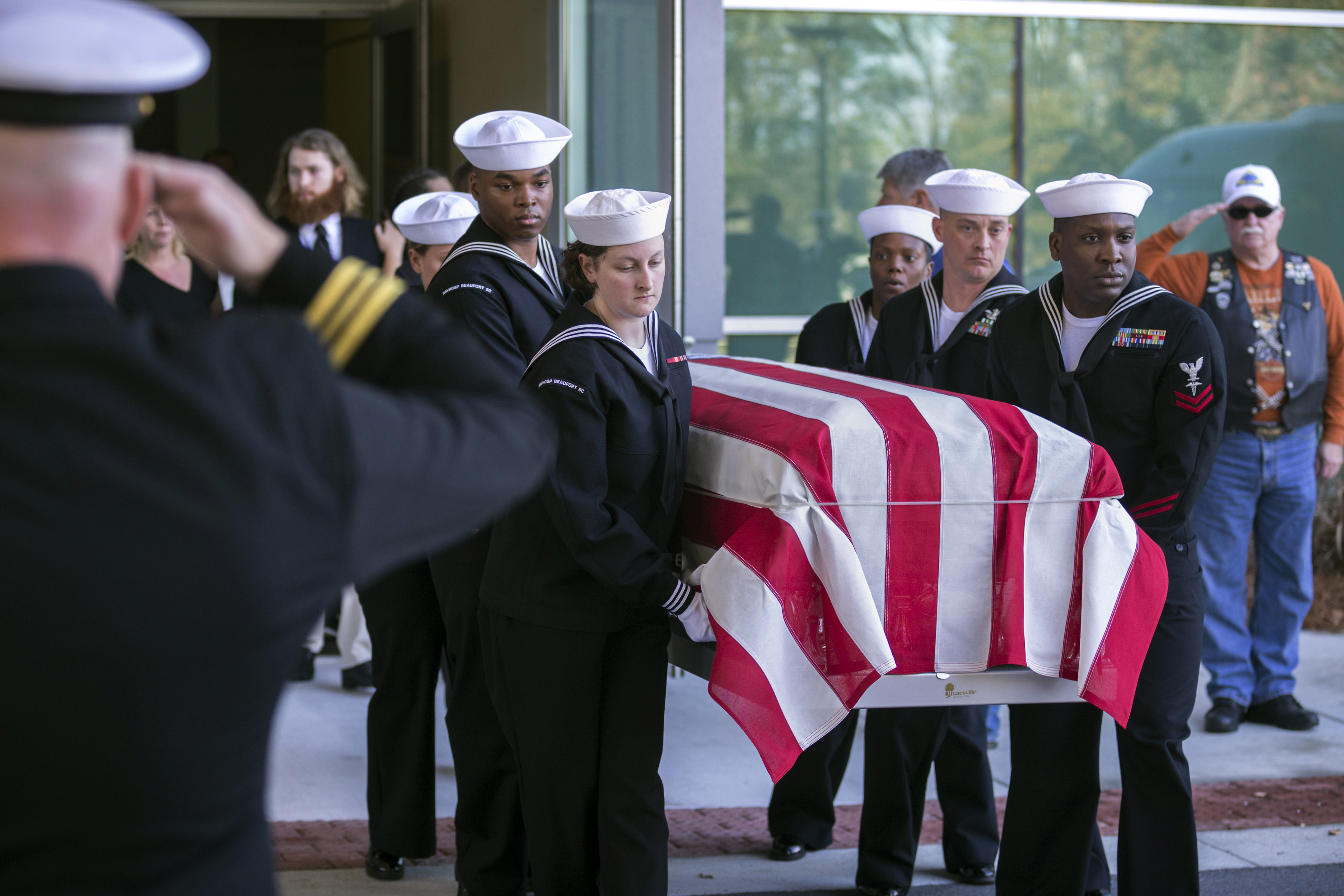 Members of a U.S. Navy honor guard carry the casket of U.S. Navy Airmen Apprentice Cameron Walters after his funeral service in Savannah, Ga., Monday, Dec. 16, 2019. Walters was one of three Navy sailors killed in a Saudi gunman's attack at Naval Air Station Pensacola in Florida on Dec. 6.
