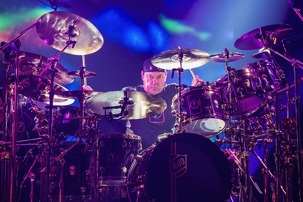Neil Peart of Rush performs on stage during the R40 LIVE Tour at KeyArena on July 19, 2015 in Seattle, Washington.
