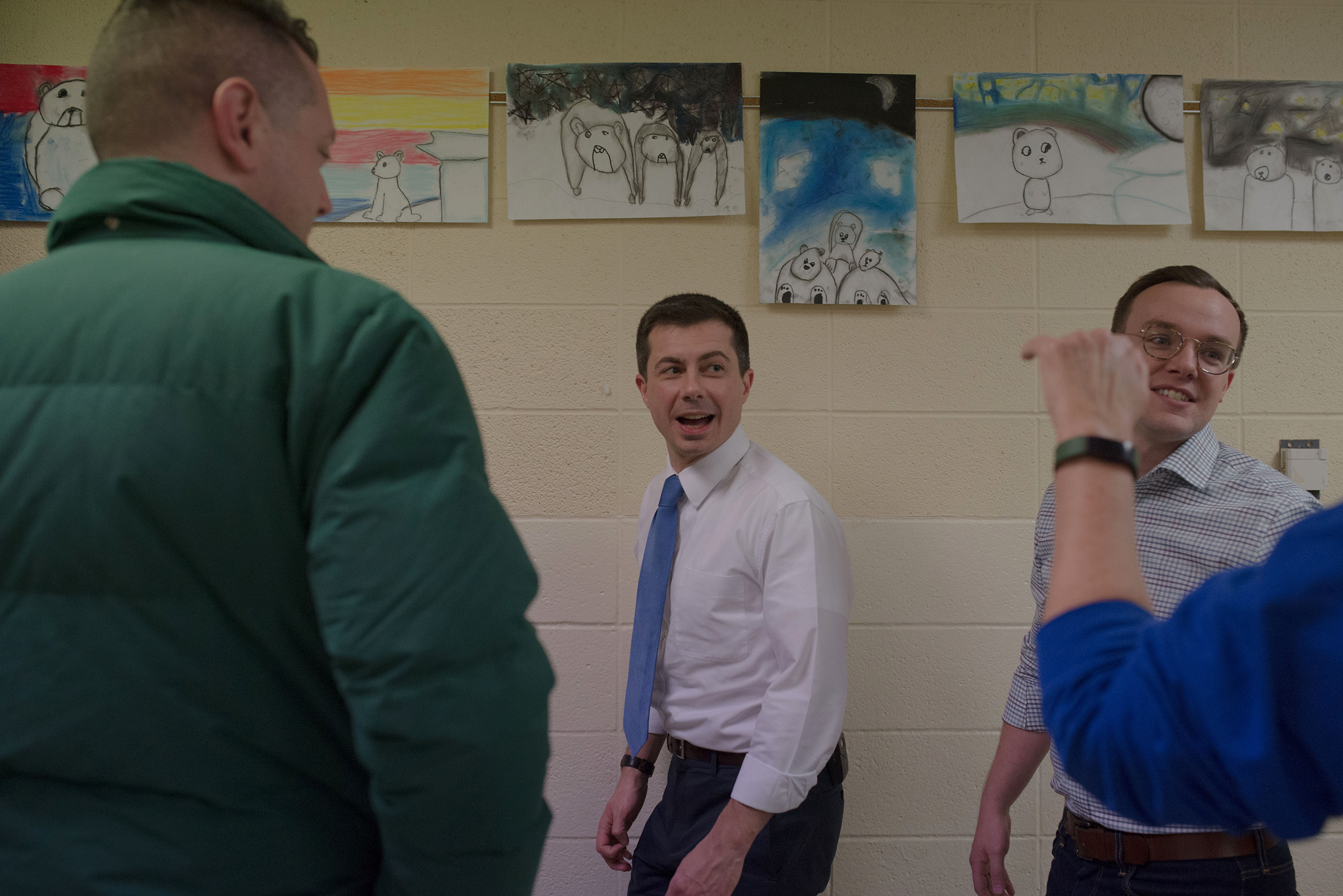 Democratic presidential candidate and South Bend, Ind., Mayor Pete Buttigieg arrives at a campaign event with his and husband Chasten Glezman (R) at Town Hall in Vinton, IA on Jan. 27, 2020.