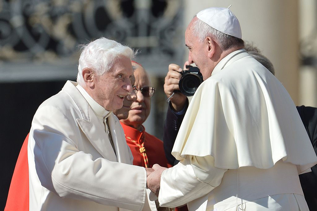 Pope emeritus Benedict XVI (left) emerged from retirement to co-author a bombshell book defending celibacy in the priesthood as Pope Francis considers relaxing the rules. He is pictured speaking with Pope Francis during a papal mass for elderly people at St Peter's square on Sept. 28, 2014 at the Vatican.