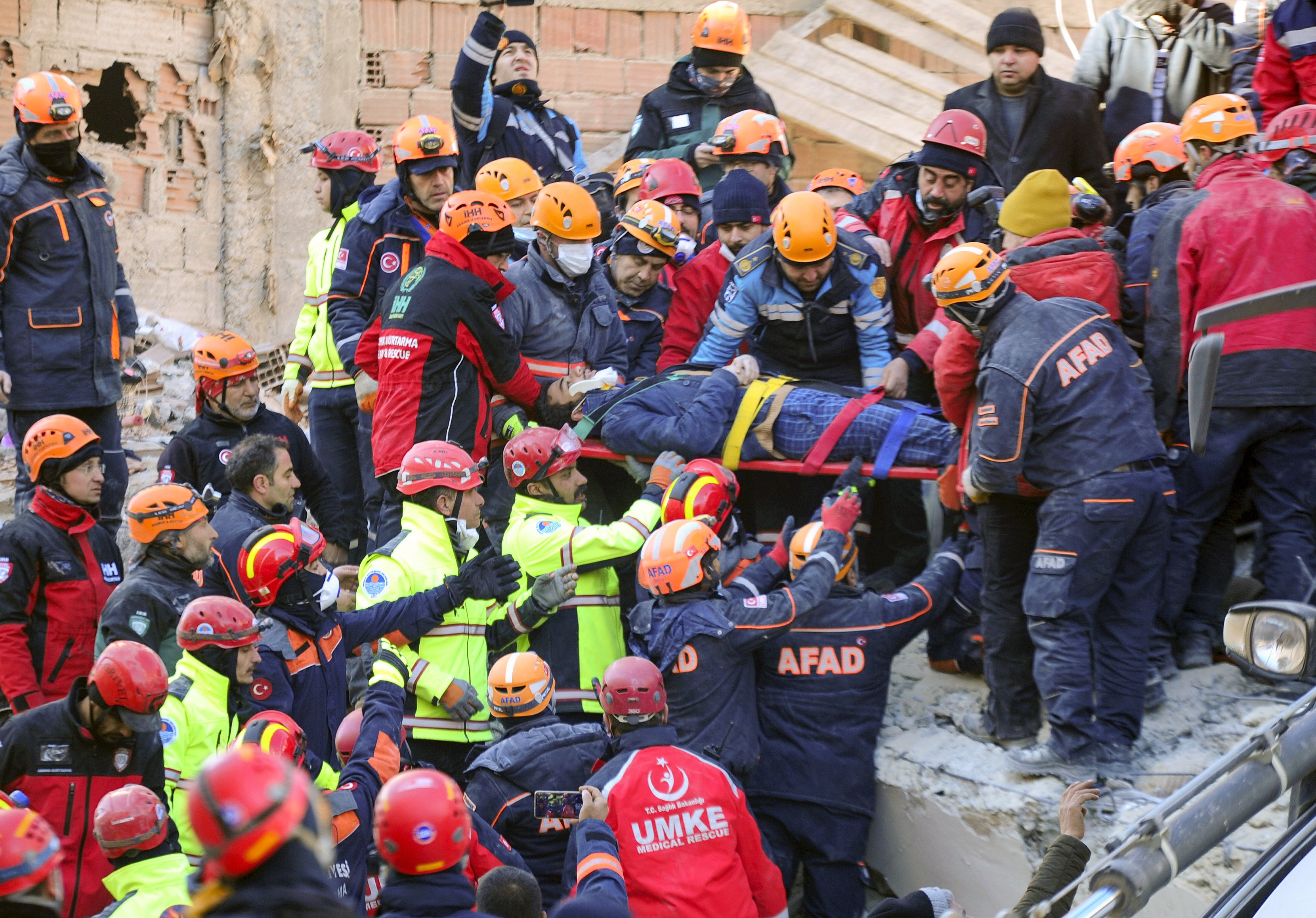 Rescuers work on a collapsed building after a strong earthquake struck in Elazig in the eastern Turkey, on Jan. 25, 2020.