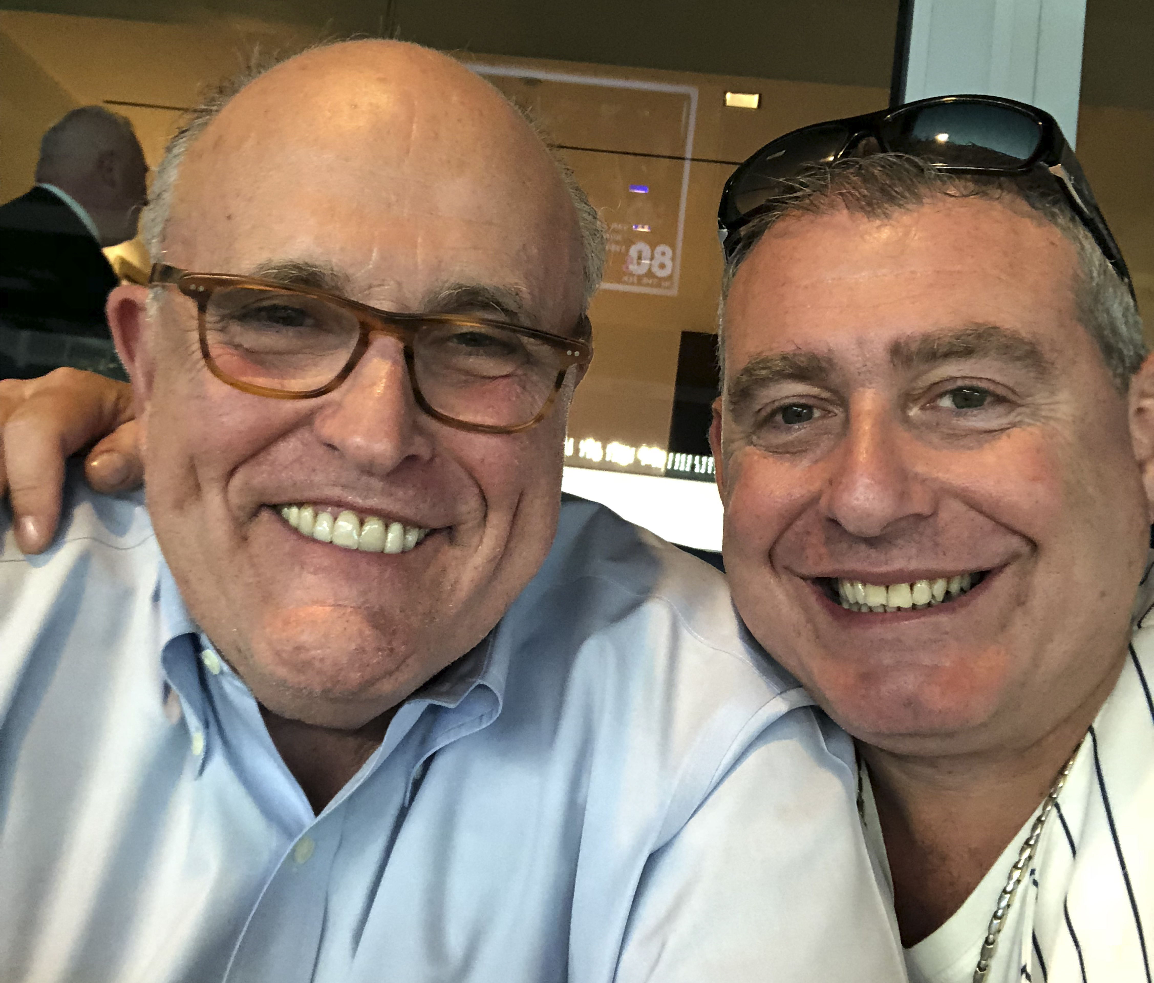 This undated image released by the House Judiciary Committee from documents provided by Lev Parnas to the committee in the impeachment probe against President Donald Trump, shows a photo of Lev Parnas with Rudy Giuliani.