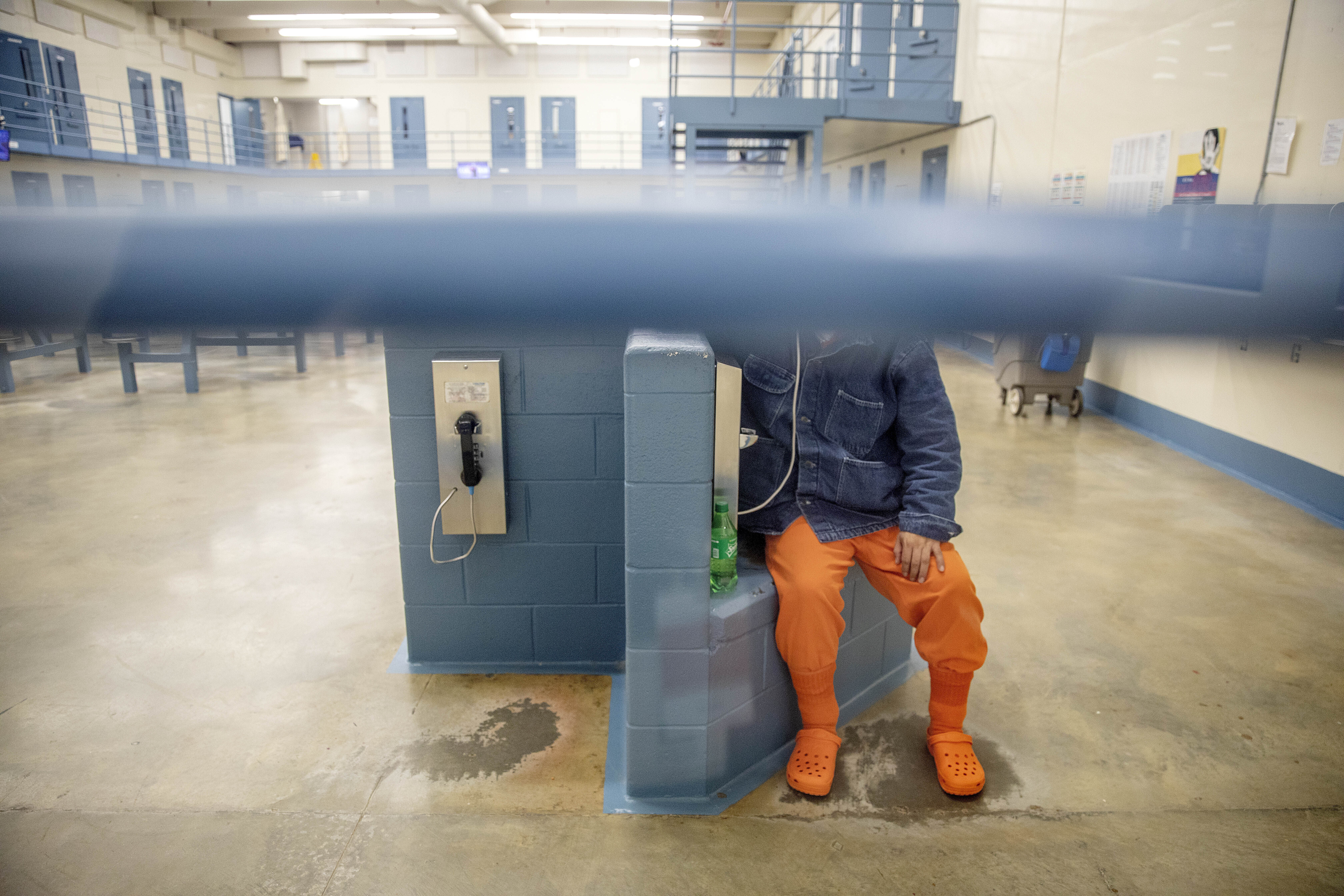A detainee talks on the phone in his pod at the Stewart Detention Center, Friday, Nov. 15, 2019, in Lumpkin, Ga.