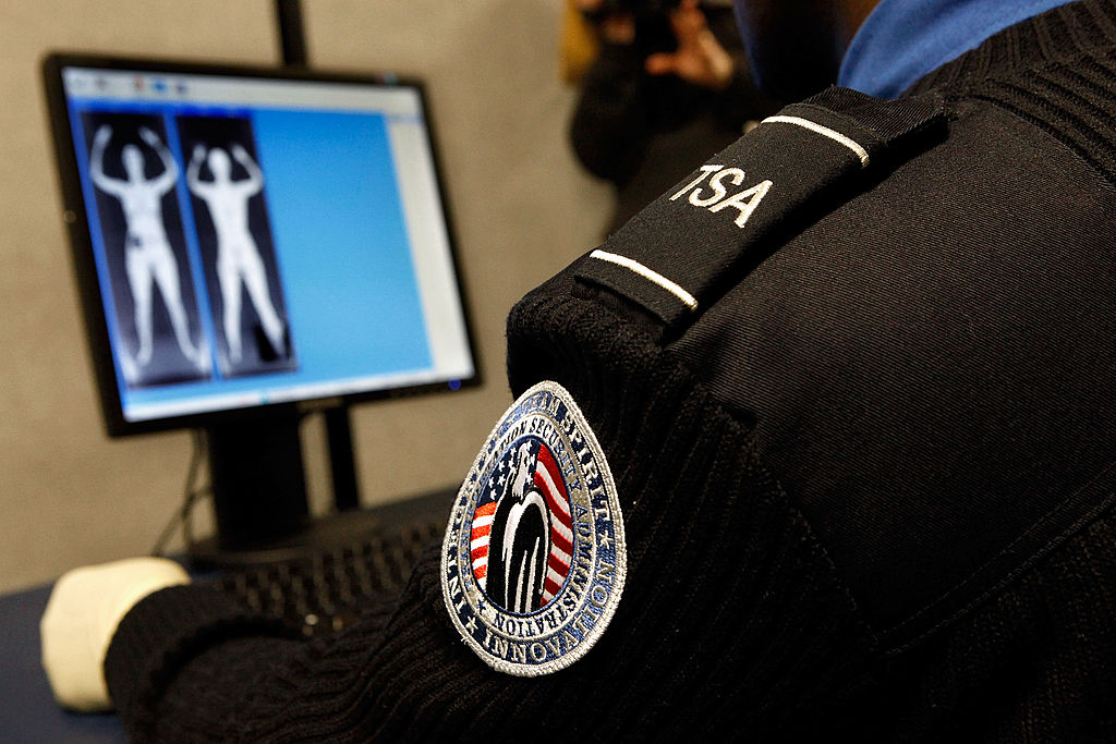 A Transportation Security Administration Security Officer looks at images created by a  backscatter  scanner at Ronald Reagan National Airport in Arlington, Va., on Dec. 30, 2009.