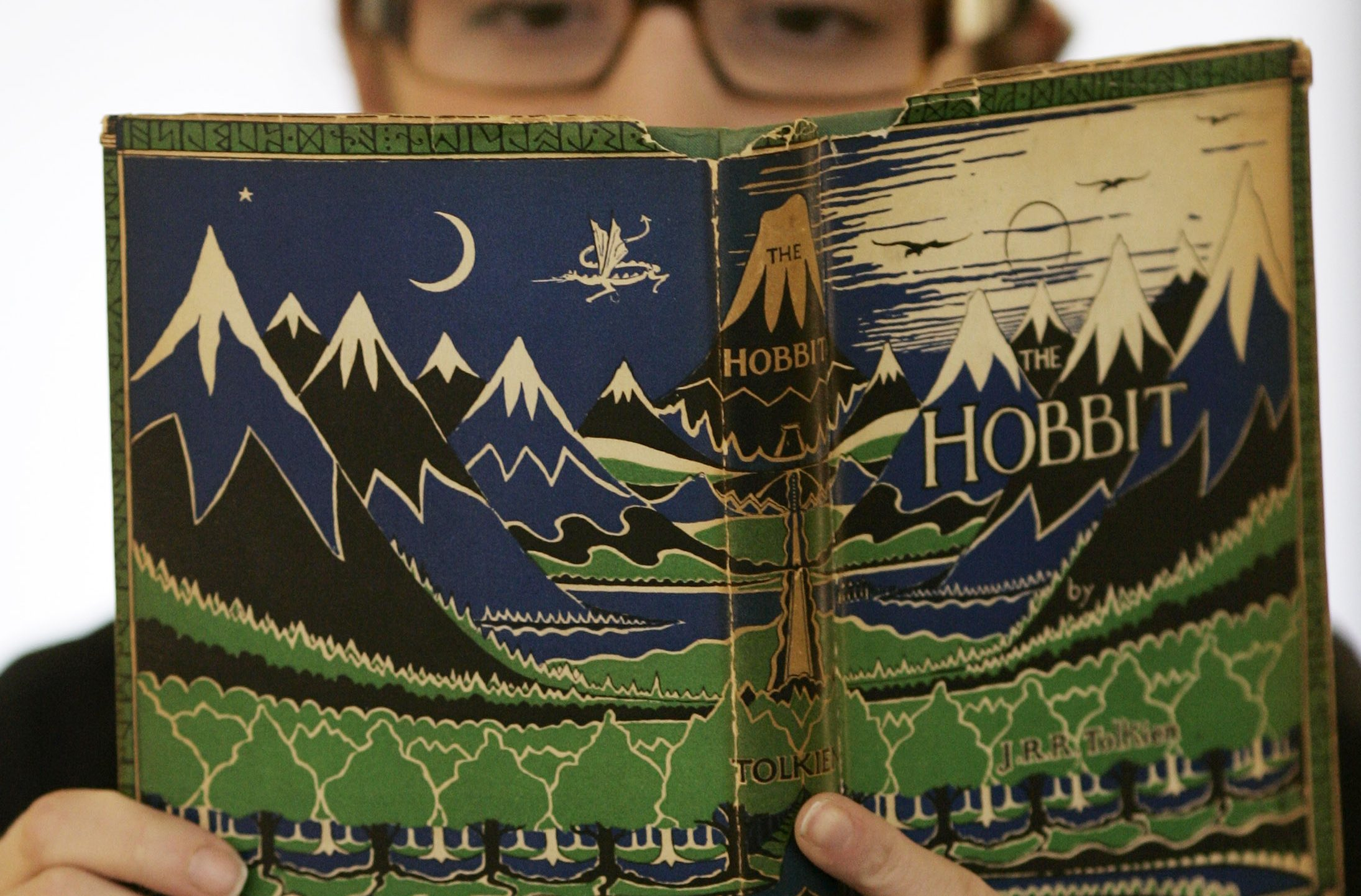 Joy Asfar, of the auction house Bonhams examines a copy of the 1937 first issue of the first edition of 'The Hobbit' by author J.R.R. Tolkien on display at the auction house in London, in this March 17, 2008 file photo.