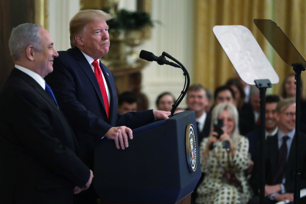 U.S. President Donald Trump speaks during a press conference with Israeli Prime Minister Benjamin Netanyahu (L) in the East Room of the White House on January 28, 2020 in Washington, DC.