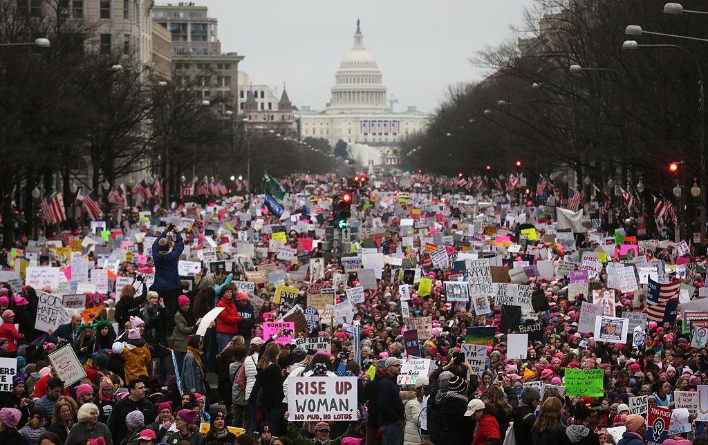 Protesters walk during the Women's March on Washington, with the U.S. Capitol in the background in Washington, D.C., on Jan. 21, 2017.