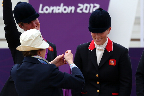 Zara Phillips is presented a silver medal by her mother, Princess Anne, the Princess Royal, after the Eventing Team Jumping Final Equestrian event on Day 4 of the London 2012 Olympic Games at Greenwich Park in London, England on July 31, 2012.