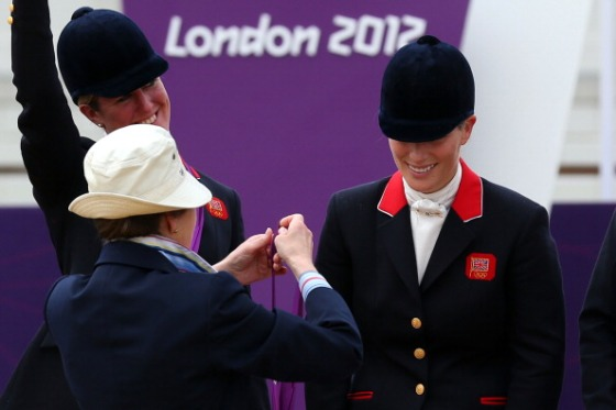 Zara Phillips is presented a silver medal by her mother, Princess Anne, after the Eventing Team Jumping Final Equestrian event on Day 4 of the London 2012 Olympic Games at Greenwich Park in London, England on July 31, 2012.