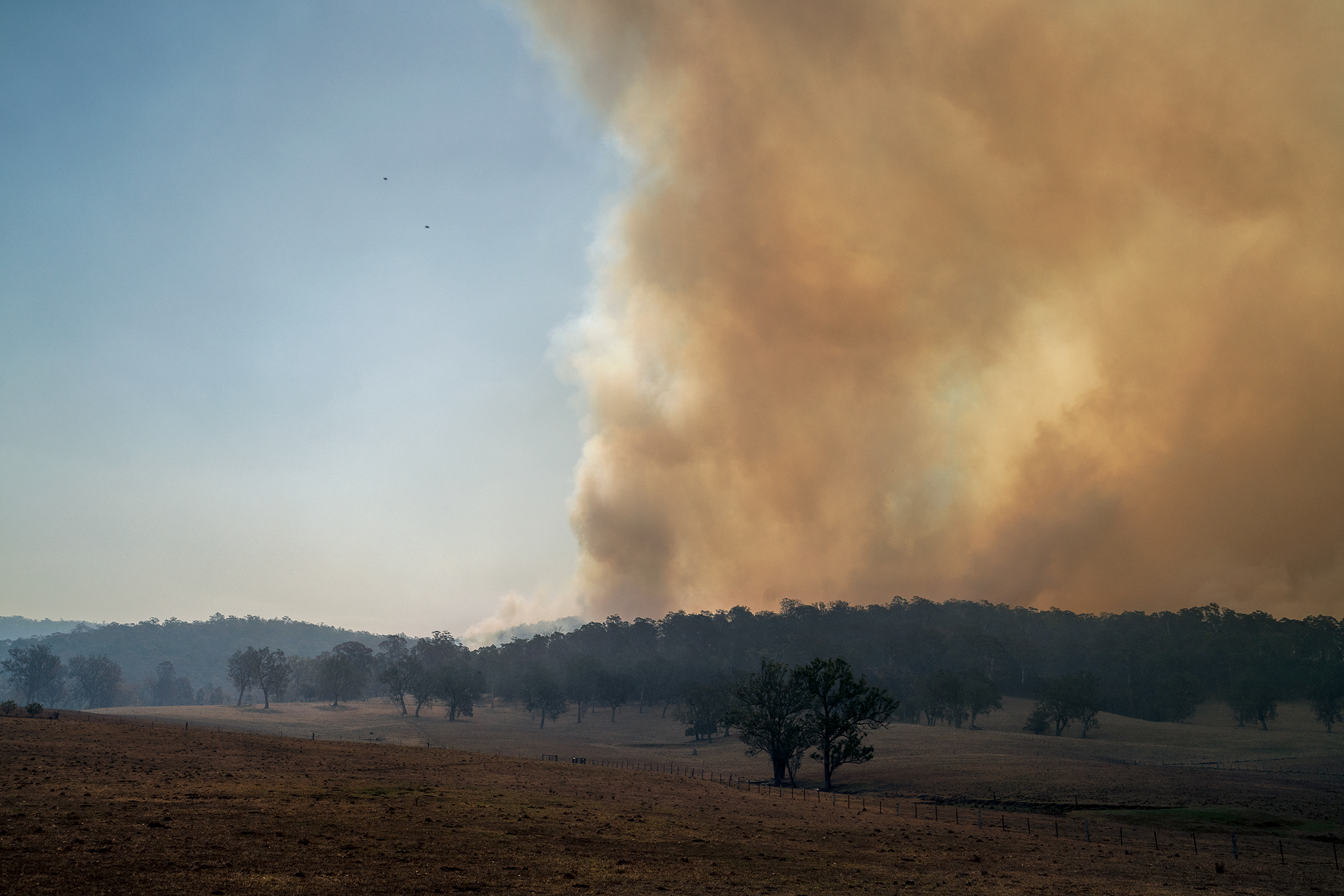 Orange smoke fills the sky near a property north of Moruya, New South Wales, on Jan. 4.