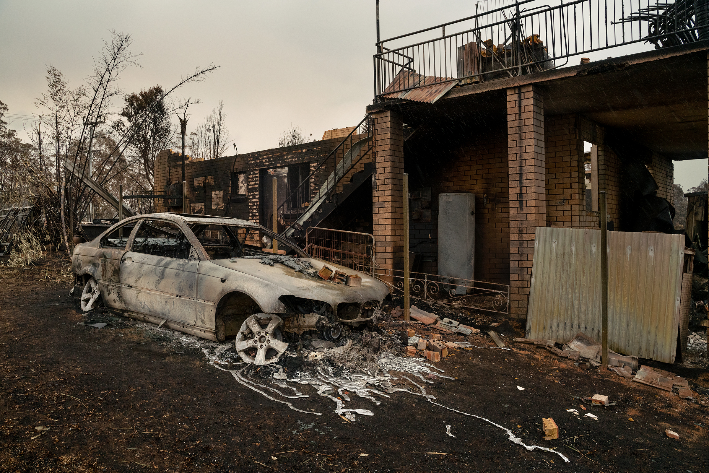A damaged property and vehicle in Lake Conjola, New South Wales, on Jan. 5.