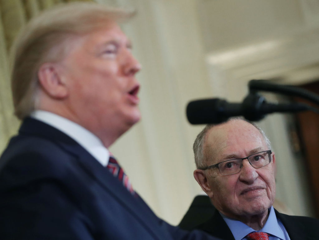Alan Dershowitz listens to President Donald Trump speak during a Hanukkah Reception in the East Room of the White House on December 11, 2019 in Washington, DC.