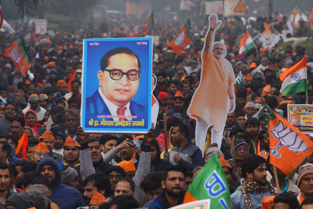 A BJP supporter holds up an image of B.R Ambedkar during a rally for Indian Prime Minister Narendra Modi on December 22, 2019 in New Delhi, India.