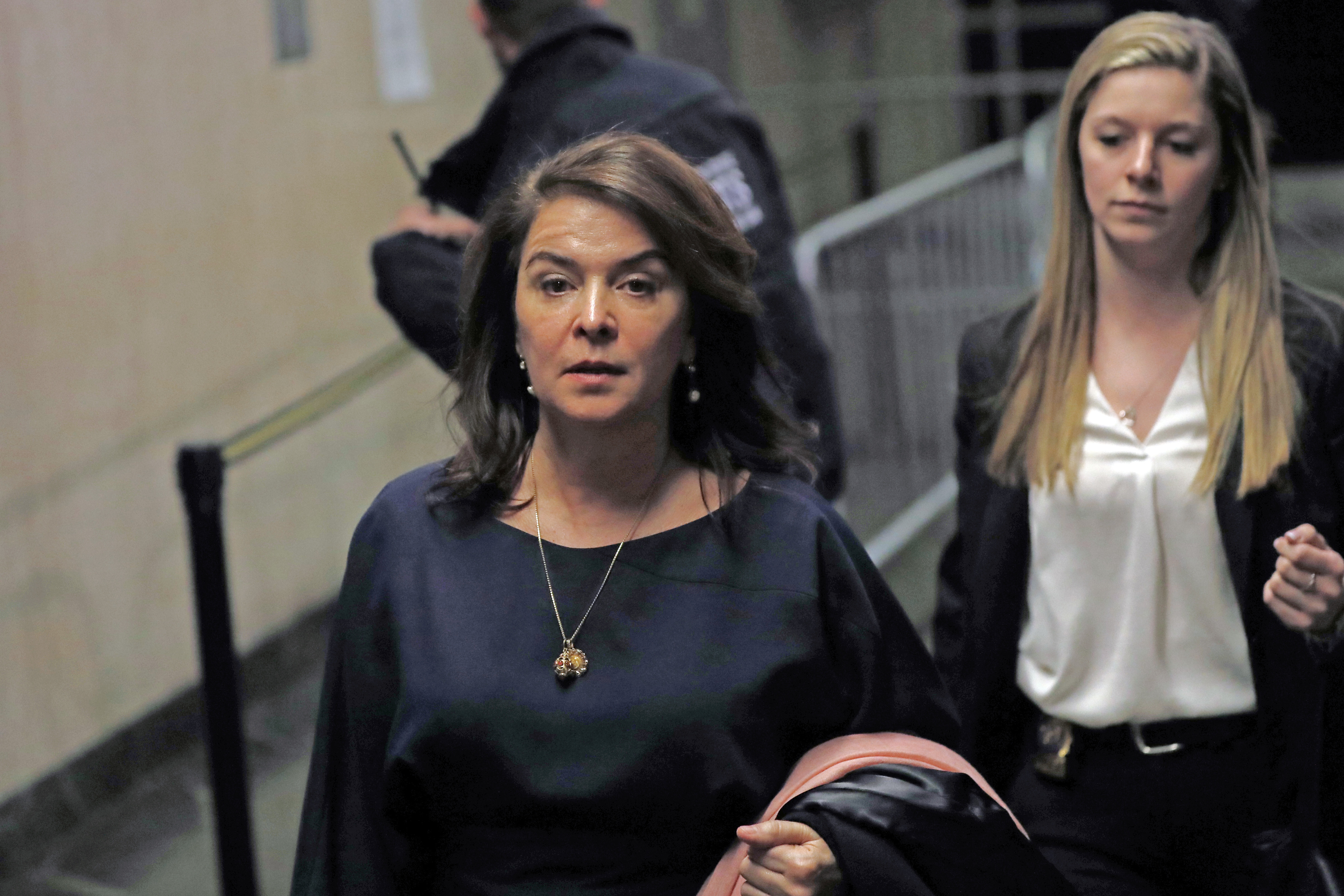 Actress Annabella Sciorra, left, leaves Manhattan Criminal Court after appearing at Harvey Weinstein's rape and sexual assault trial, Thursday, Jan. 23, 2020, in New York.