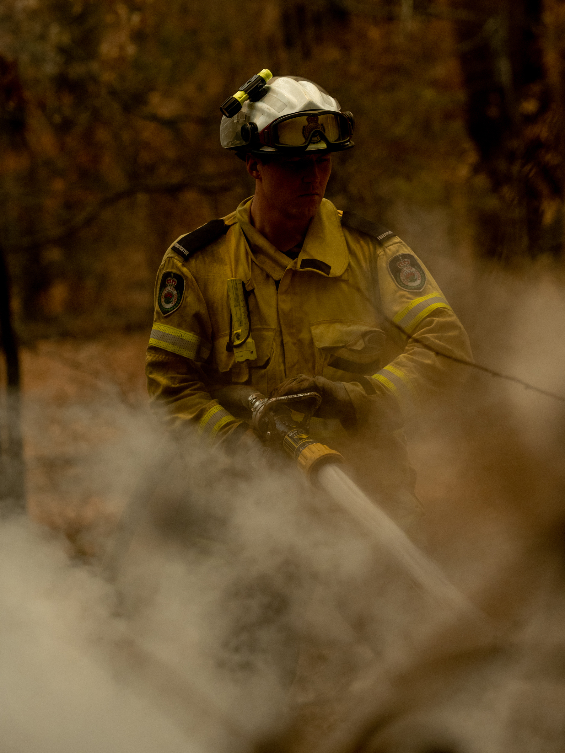A New South Wales Rural Fire Service (RFS) member fights a fire in Lake Innes, Australia on Dec. 6, 2019.