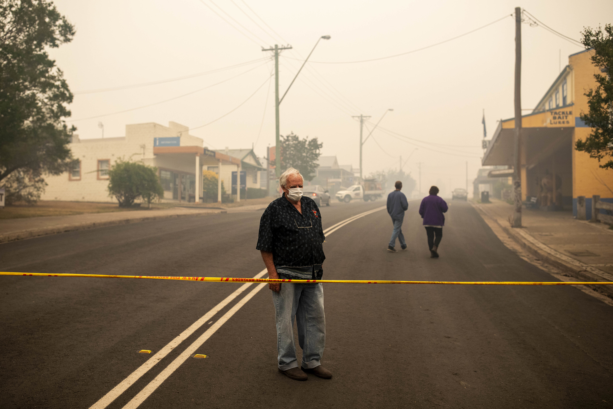A resident looks at destroyed buildings in Cobargo, New South Wales, on Jan. 1.
