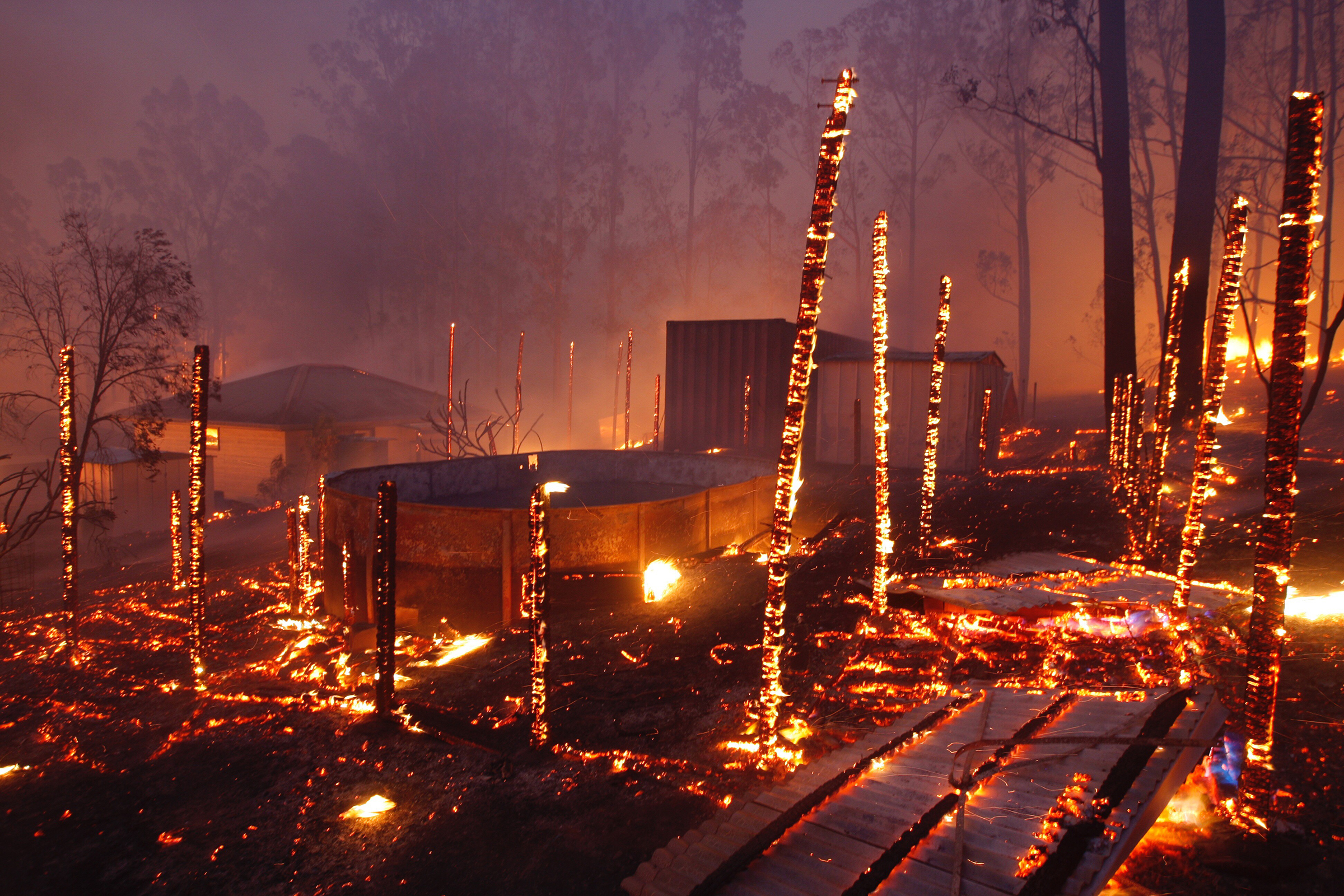 A bushfire burns through properties in the township of Rainbow Flat, New South Wales, on Nov. 9, 2019.