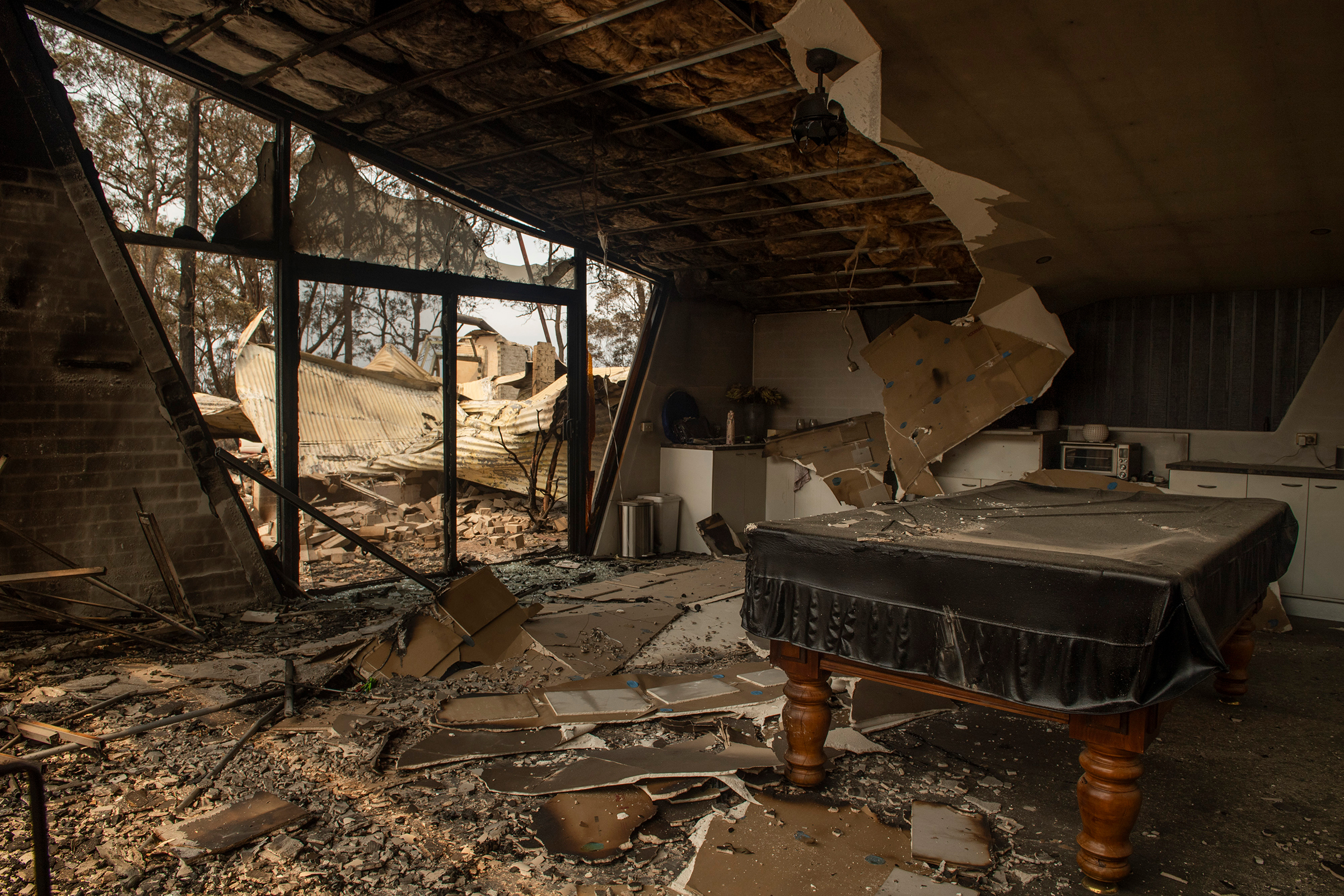 A destroyed house along The Ridge Road between Batemans Bay and Surf Beach on Jan. 3.