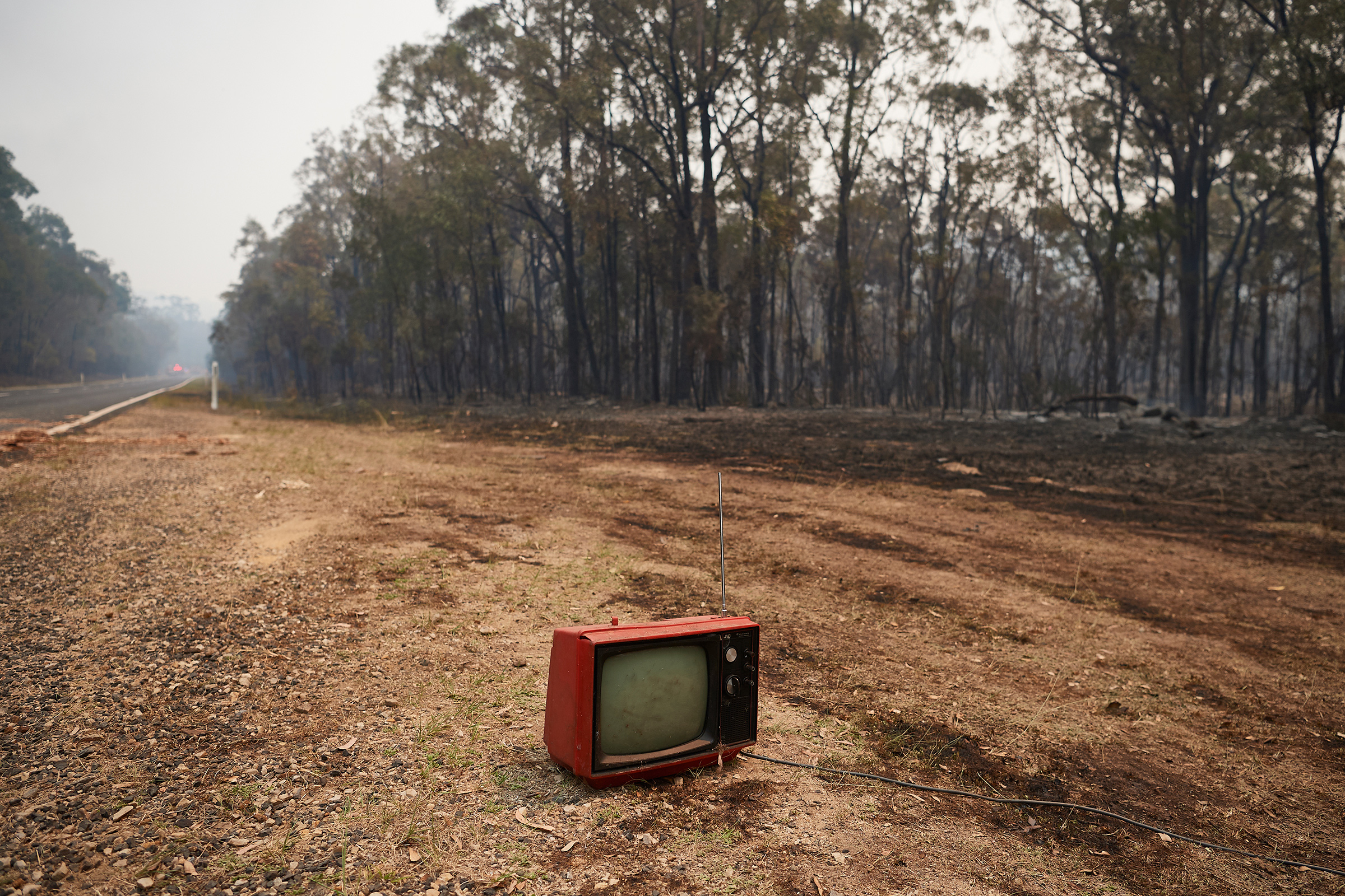 A dumped vintage TV remains intact along Putty Road after devastating fires tore through areas near Colo Heights on Nov. 14, 2019.