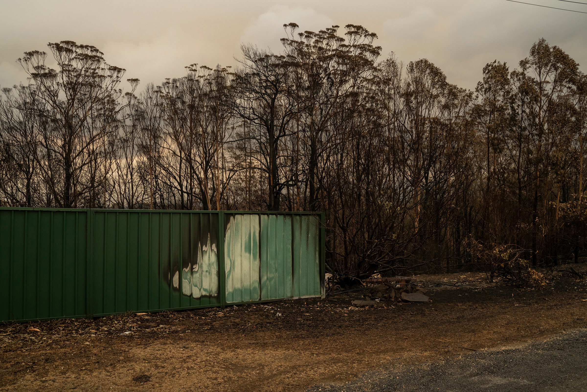 A burned fence in Lake Conjola on Jan. 5. The community was devastated by flames in late December.
