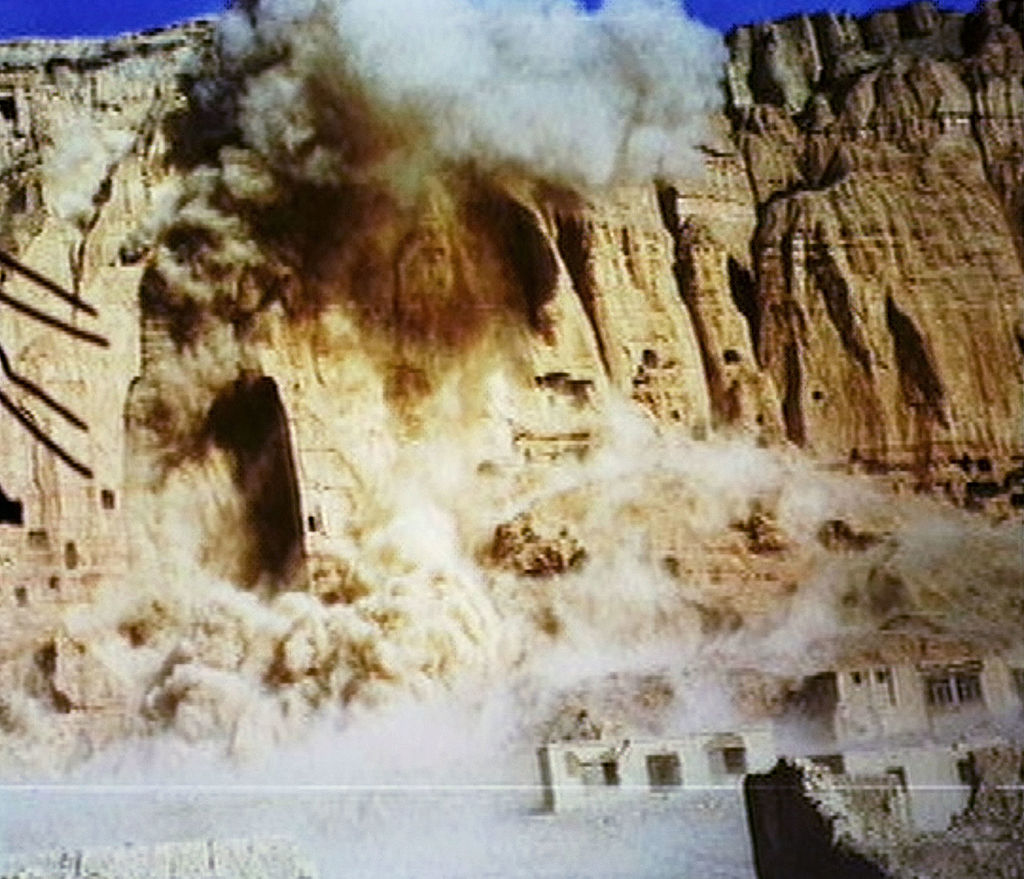 The giant Buddhas of Bamiyan are destroyed by the Taliban government on March 12, 2001 in Bamiyan, Afghanistan. The two enormous statues, measuring 175 feet in height, were carved into sandstone cliffs at Bamiyan by Buddhist worshippers who traveled the Silk Road from China in the third century A.D.