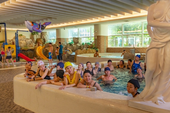 Supporters at a swimming pool wait for the President's arrival during a visit on Oct. 5.