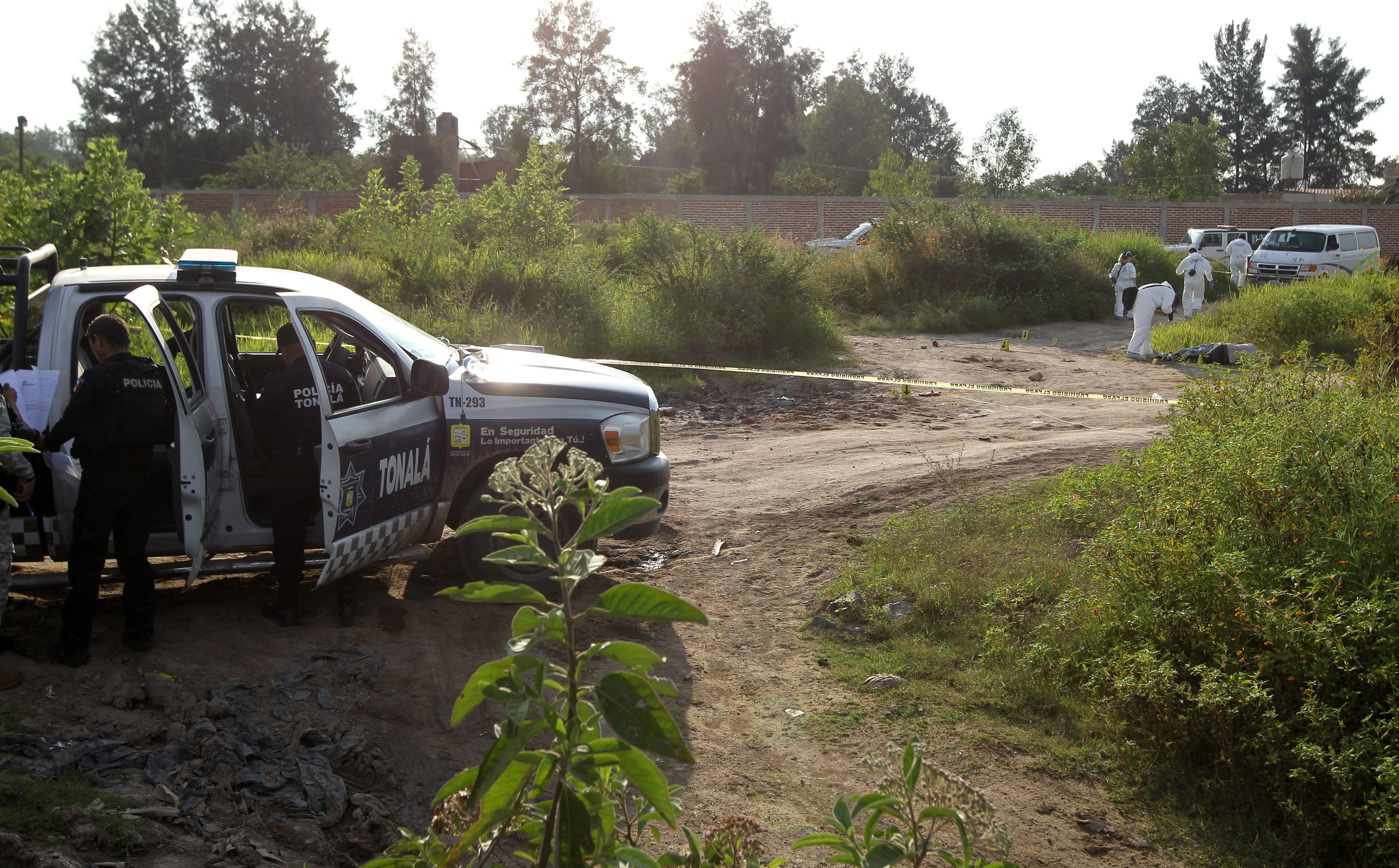 Forensic personnel work at a crime scene in Tonala, Mexico on Oct. 13, 2018.