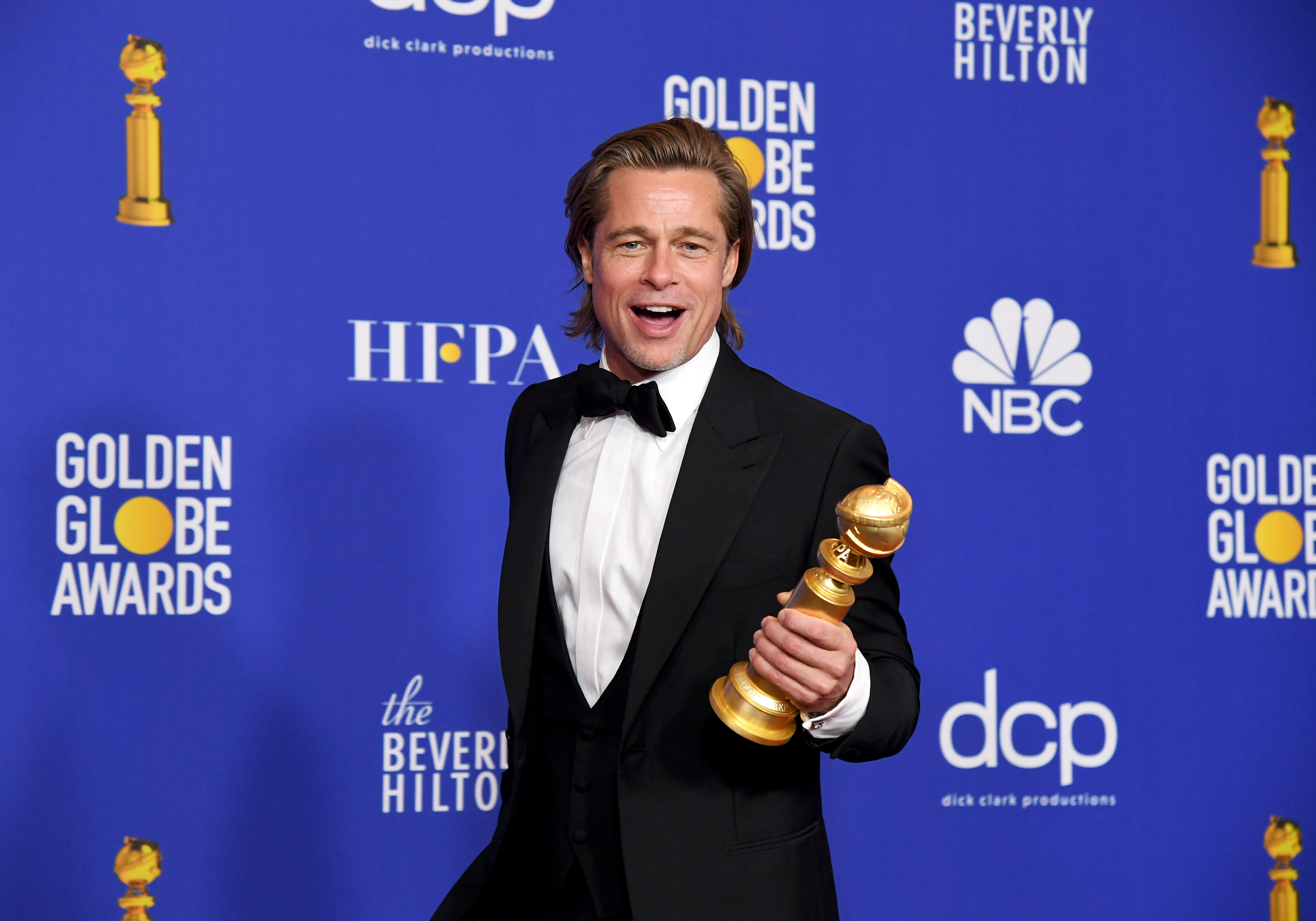 Brad Pitt, winner of Best Performance by a Supporting Actor in a Motion Picture, poses in the press room during the 77th Annual Golden Globe Awards.
