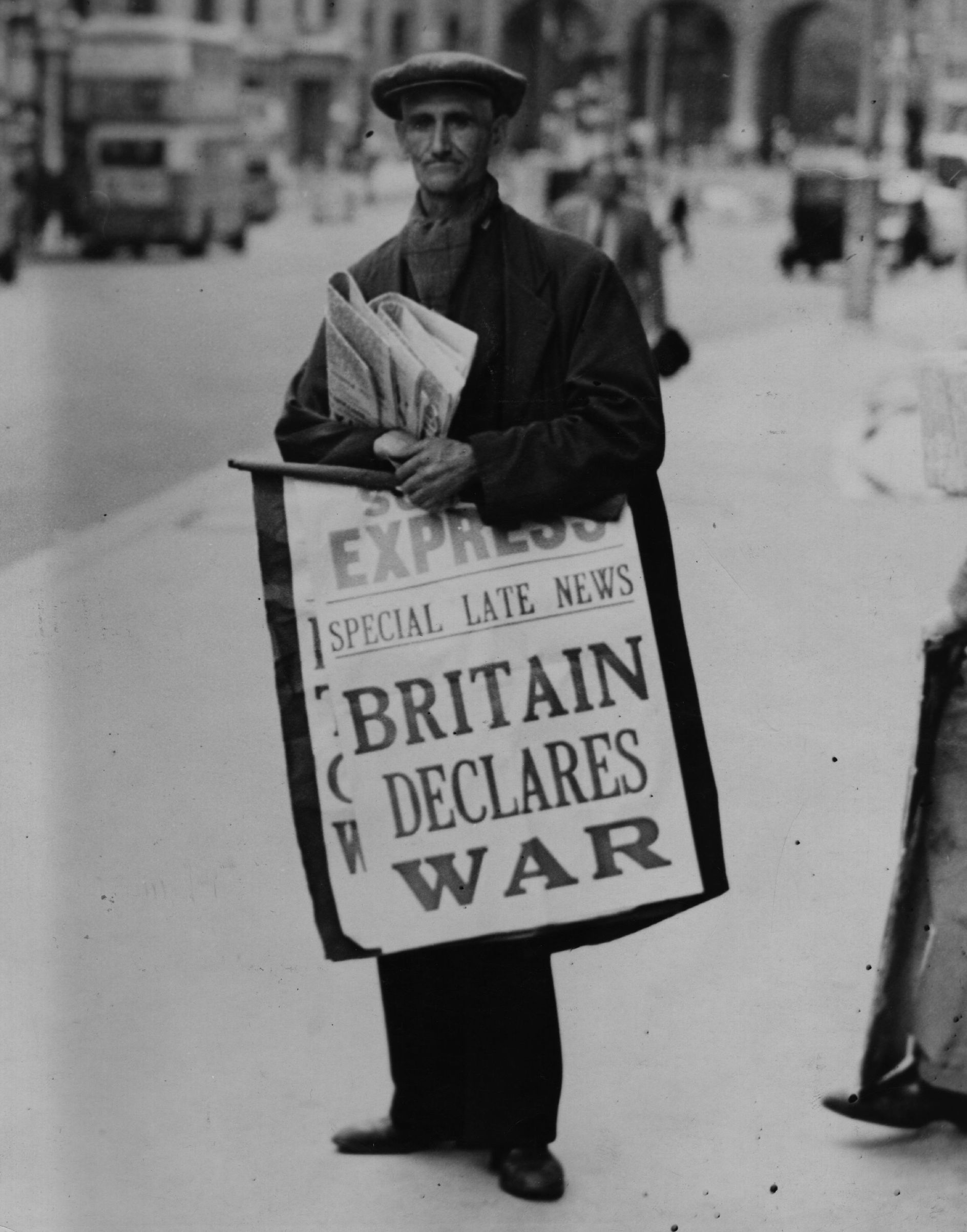 A newspaper seller carries a hoarding pronouncing the declaration of war between Britain and Germany, on the Strand, heading towards Admiralty Arch in London on Aug. 1, 1939.