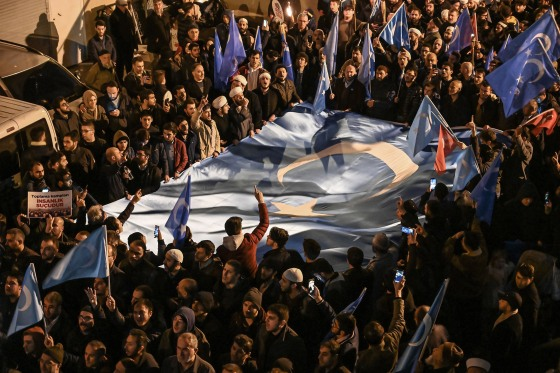 Supporters of China's Muslim Uighur minority march with flags of East Turkestan during a demonstration in Istanbul