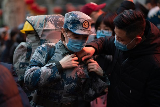 Officials wear masks to protect themselves from the virus outbreak