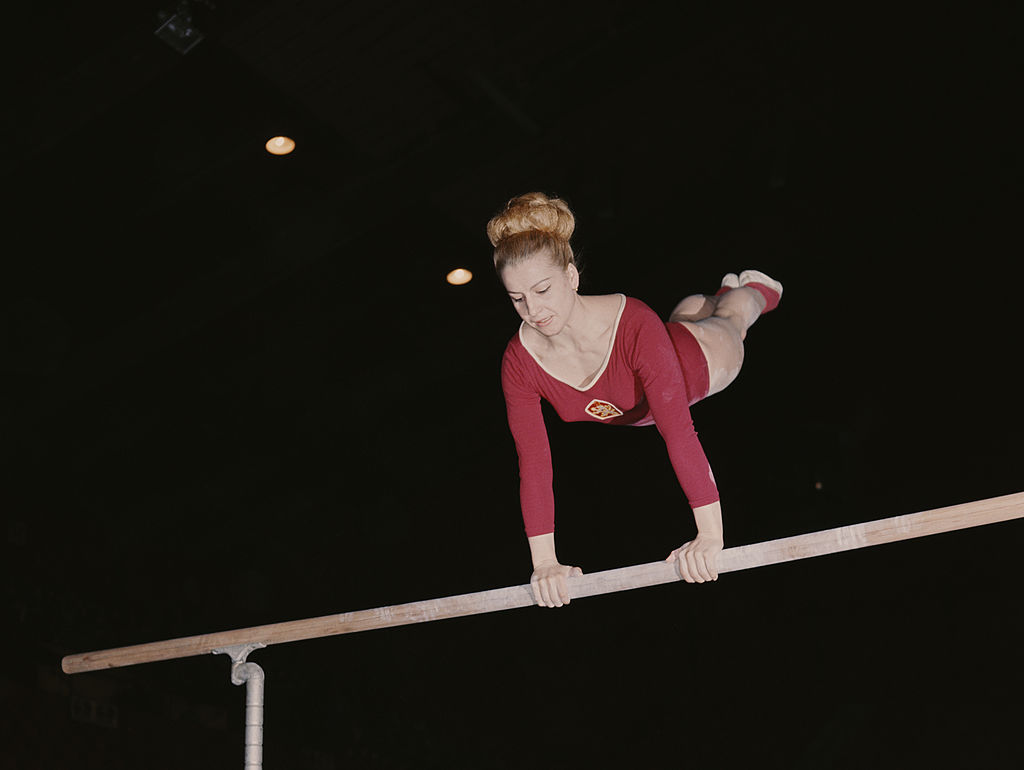 Czechoslovakian gymnast and seven-time Olympic Gold medallist Vera Caslavska competes on the uneven bars in 1968 in London, Great Britain.