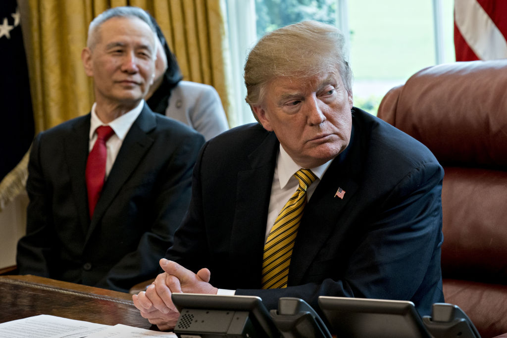 U.S. President Donald Trump and Liu He, China's vice premier, left, listen to a question during a meeting in the Oval Office of the White House in Washington, D.C., U.S., on Thursday, April 4, 2019. Trump said a deal to end the trade war between the U.S. and China isn't yet ready but a  very monumental  agreement may be announced in about a month. Photographer: Andrew Harrer/Bloomberg via Getty Images