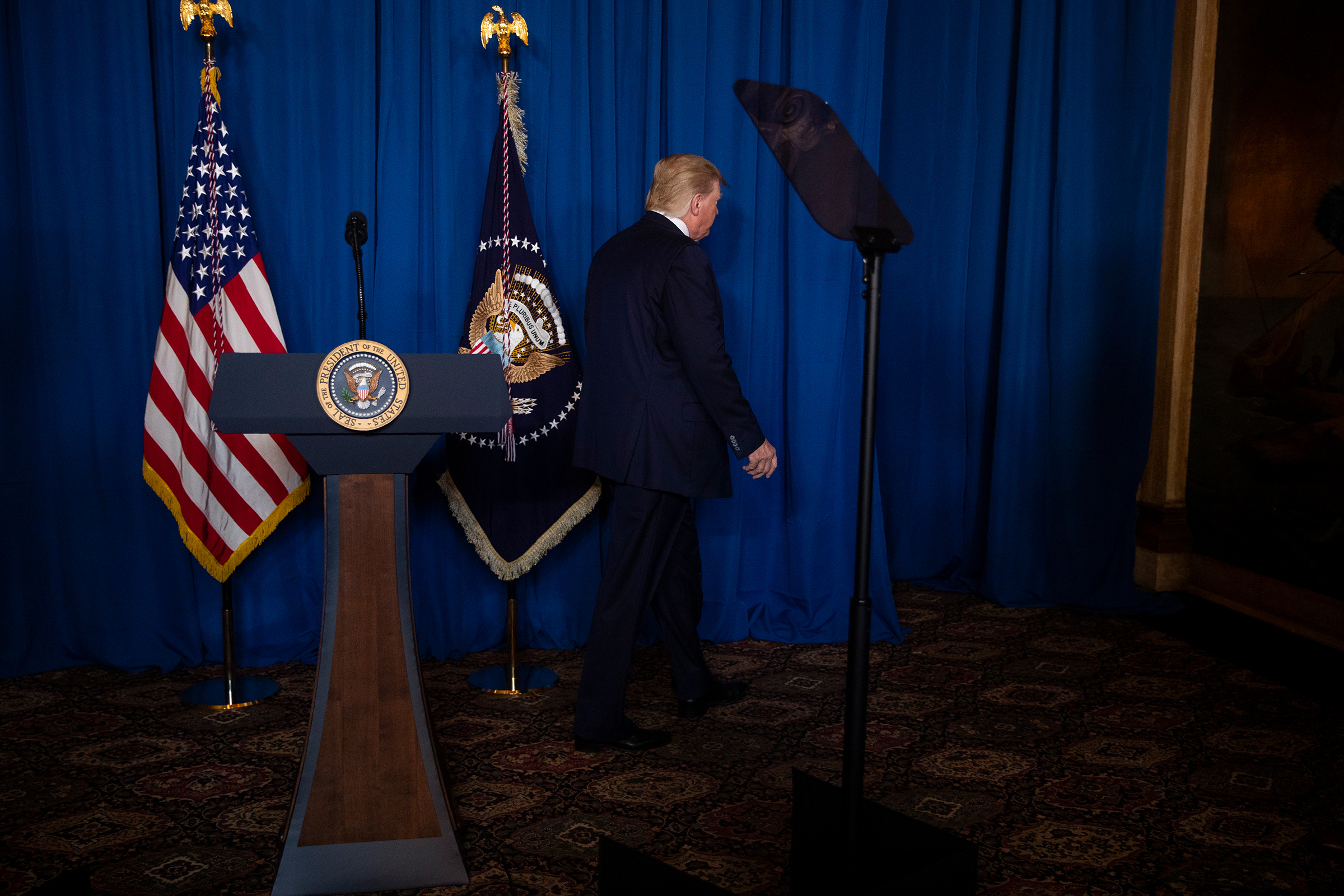 President Trump walks off after delivering remarks on Iran at his Mar-a-Lago property in Palm Beach, Fla., on Jan. 3, 2020.